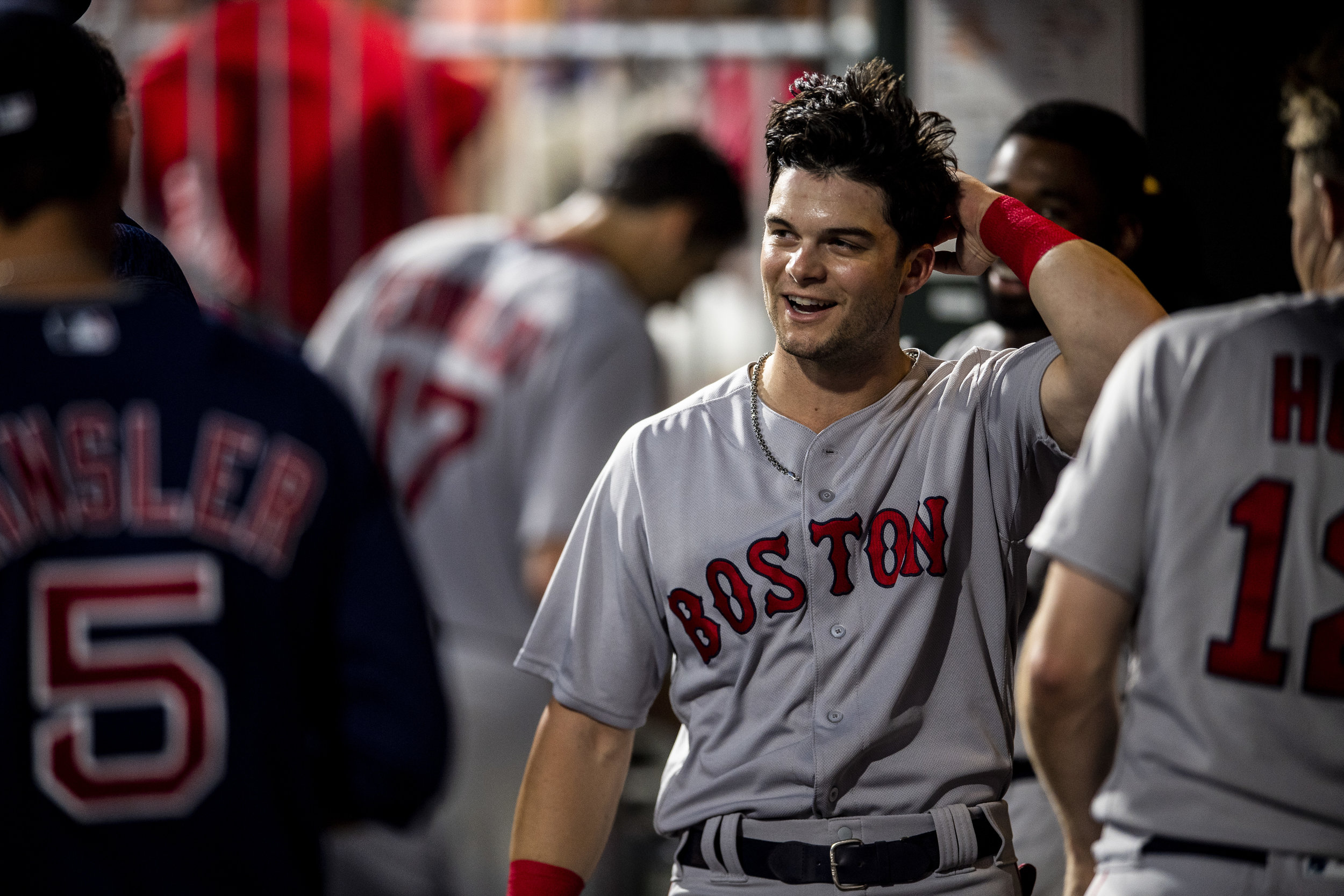 August 15, 2018, Philadelphia, PA: Boston Red Sox outfielder Andrew Benintendi pushes his hair back after celebrating score a run in the dugout as the Boston Red Sox face the Philadelphia Phillies at Citizen Bank Park in Philadelphia, Pennsylvania on Wednesday, August 15, 2018. (Photo by Matthew Thomas/Boston Red Sox)