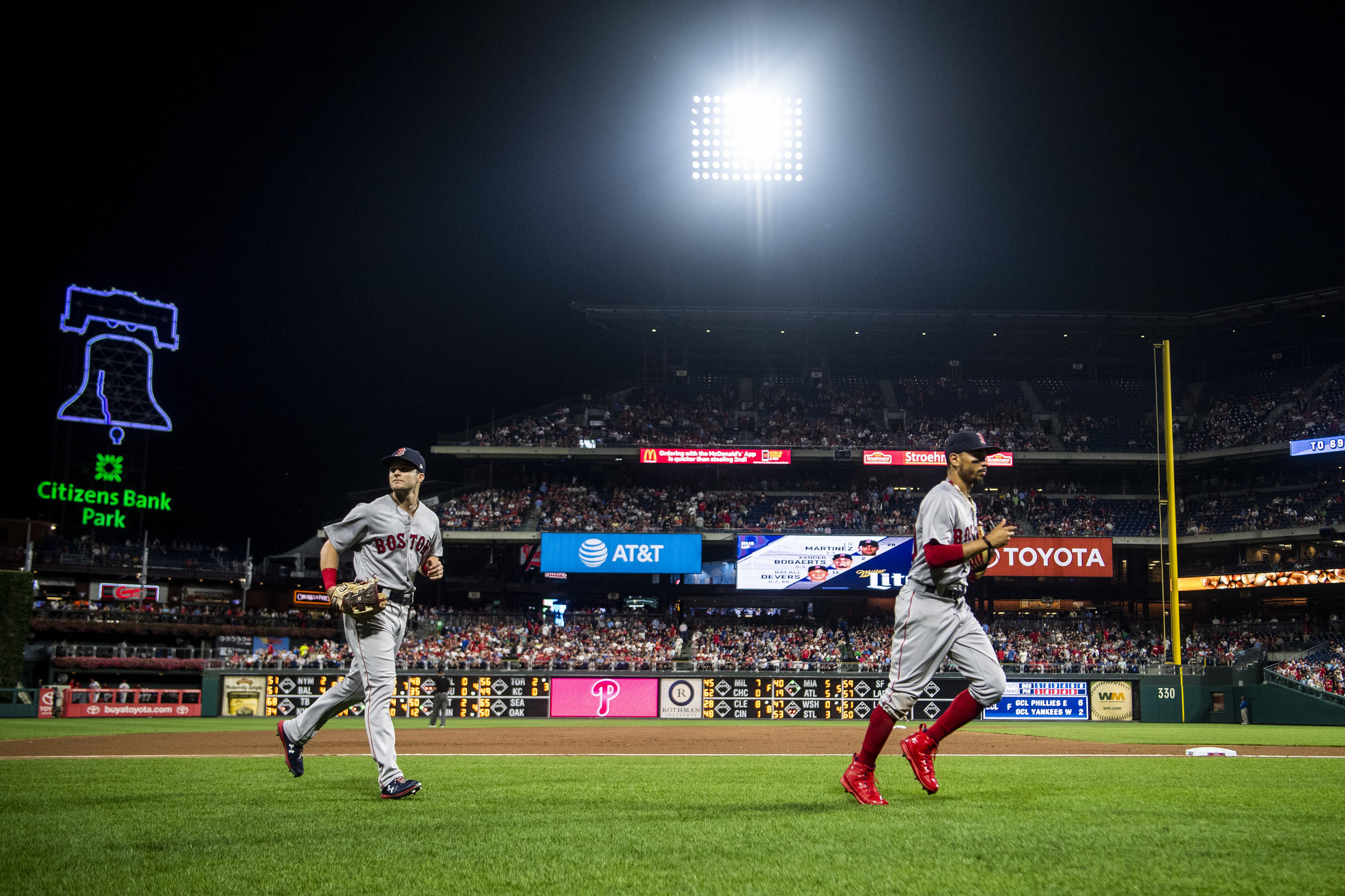 August 14, 2018, Philadelphia, PA: Boston Red Sox outfielder Mookie Betts and Boston Red Sox outfielder Andrew Benintendi makes their way in from the outfield as the Boston Red Sox face the Philadelphia Phillies at Citizen Bank Park in Philadelphia, Pennsylvania on Tuesday, August 14, 2018. (Photo by Matthew Thomas/Boston Red Sox)