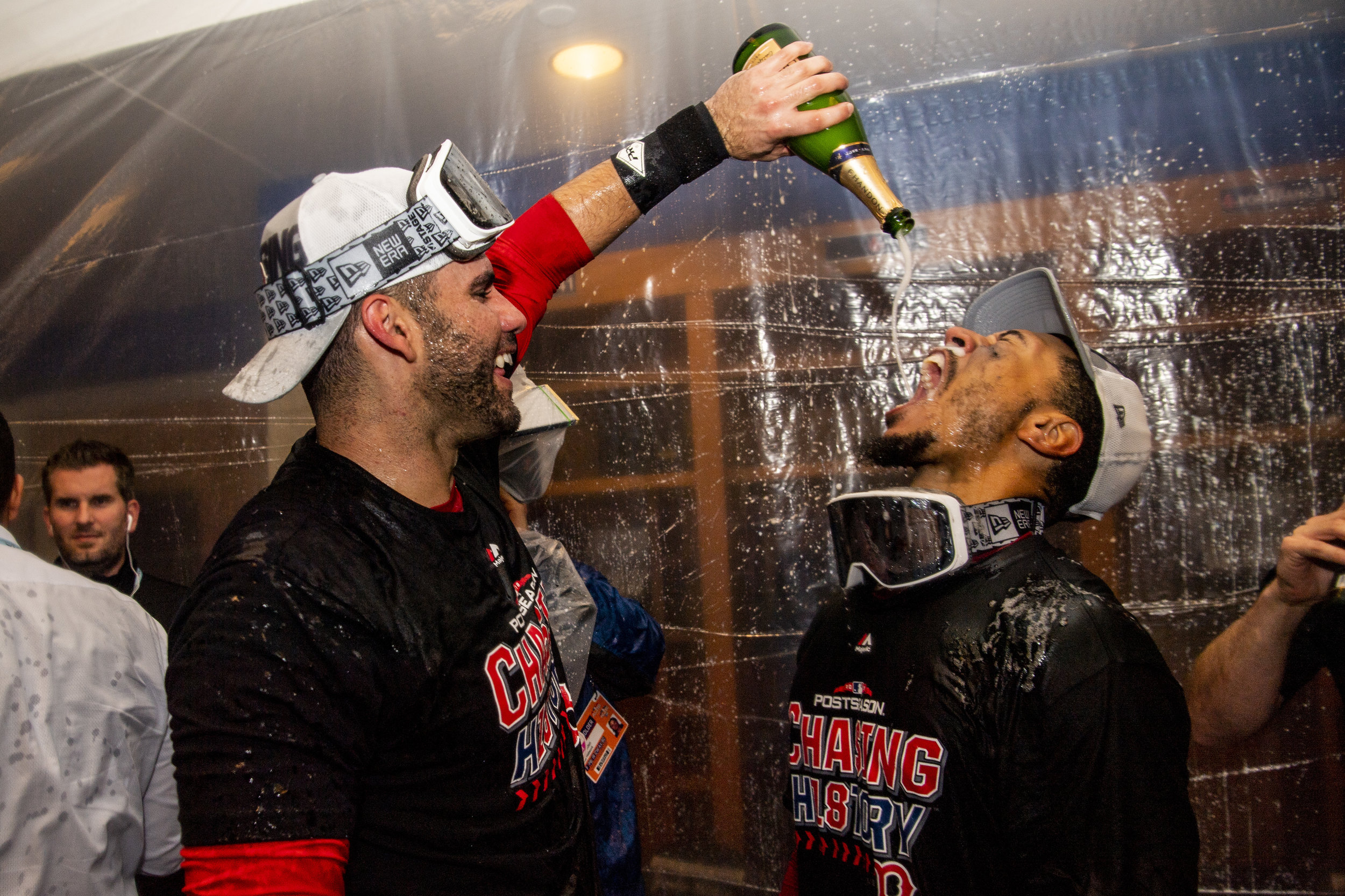 October 9, 2018, New York, NY: Boston Red Sox outfielder J.D. Martinez pours champagne on Boston Red Sox outfielder Mookie Betts after the Boston Red Sox defeated the New York Yankees in Game 4 of the ALDS to win the series at Yankee Stadium in New York, New York on Tuesday, October 9, 2018. (Photo by Matthew Thomas/Boston Red Sox)