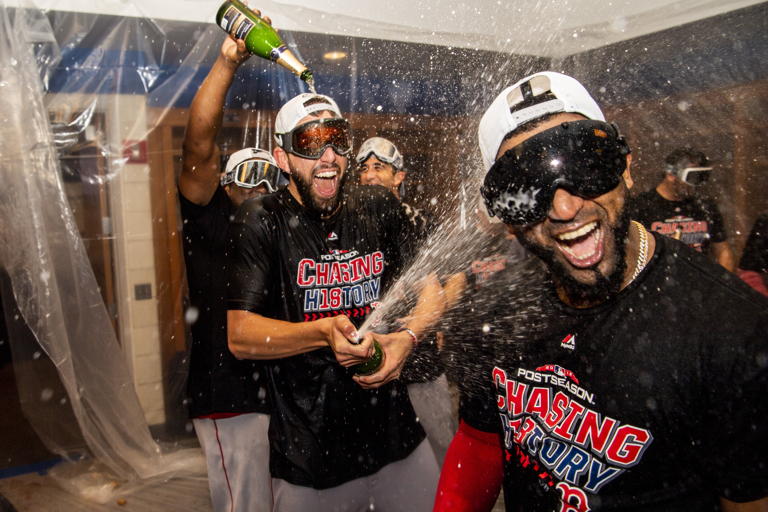 October 9, 2018, New York, NY: Boston Red Sox pitcher Matt Barnes sprays champagne on Boston Red Sox second basemen Eduardo Nunez after the Boston Red Sox defeated the New York Yankees in Game 4 of the ALDS to win the series at Yankee Stadium in New York, New York on Tuesday, October 9, 2018. (Photo by Matthew Thomas/Boston Red Sox)