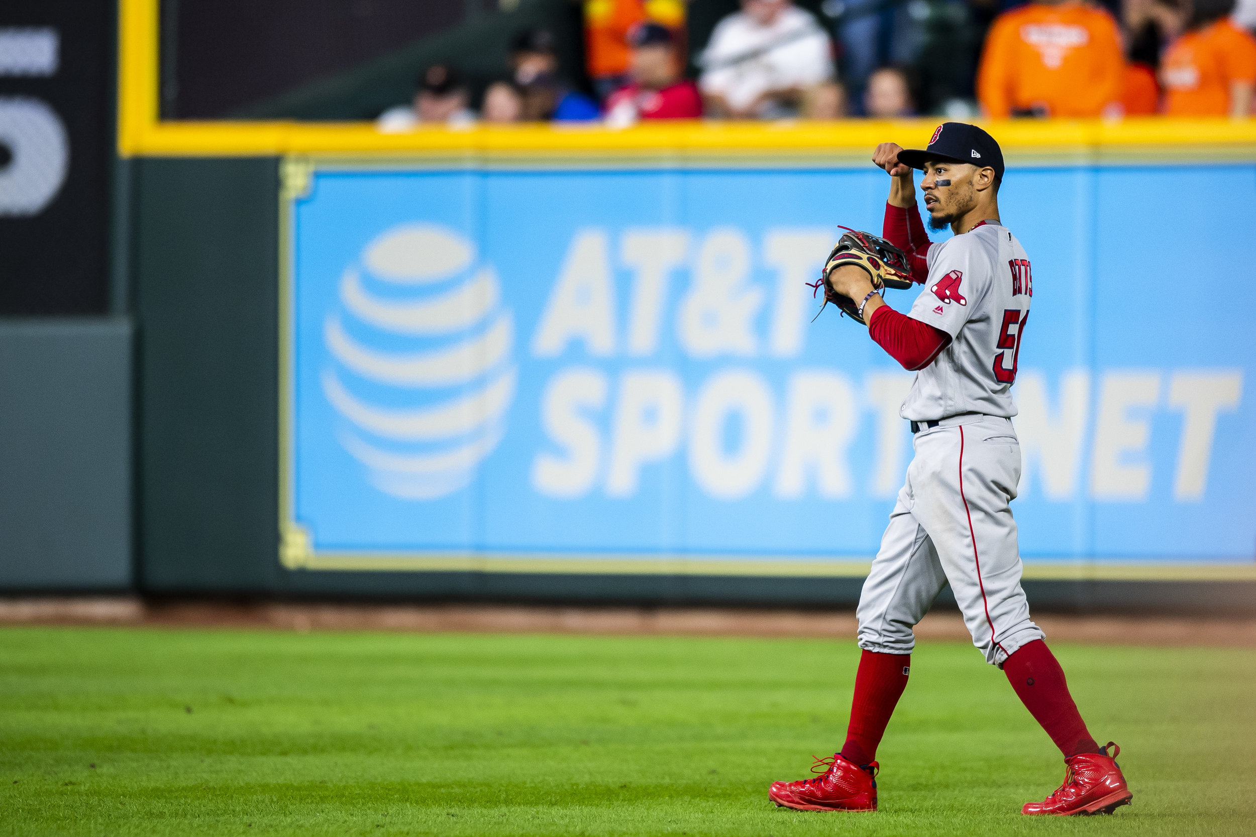 October 17, 2018, Houston, TX: Boston Red Sox outfielder Mookie Betts points to his biceps and flexes after throwing out a runner at second base as the Boston Red Sox face the Houston Astros in Game 4 of the ALCS at Minute Maid Park in Houston, Texas on Wednesday, October 17, 2018. (Photo by Matthew Thomas/Boston Red Sox)