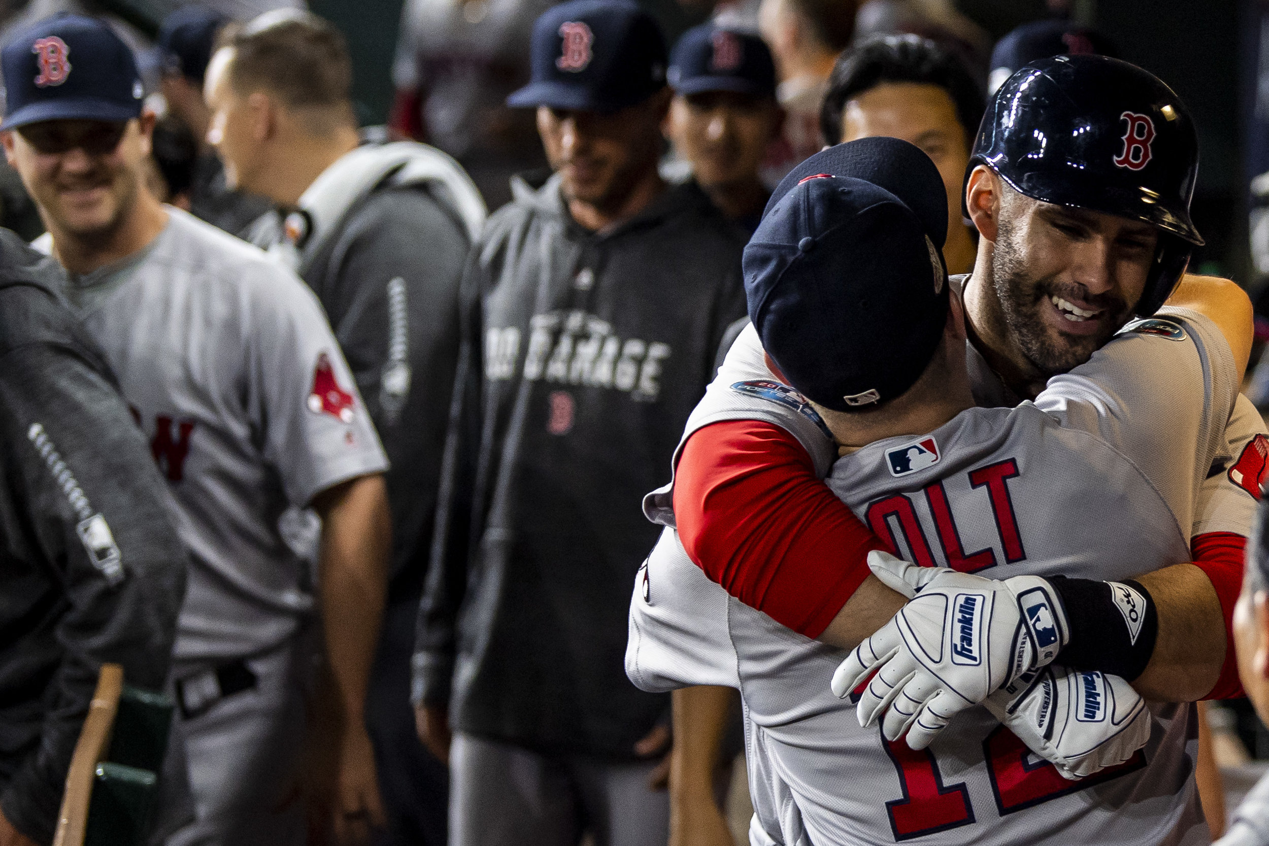 October 18, 2018, Houston, TX: Boston Red Sox outfielder J.D. Martinez hugs Boston Red Sox infielder Brock Holt after hitting a home run as the Boston Red Sox face the Houston Astros in Game 5 of the ALCS at Minute Maid Park in Houston, Texas on Thursday, October 18, 2018. (Photo by Matthew Thomas/Boston Red Sox)