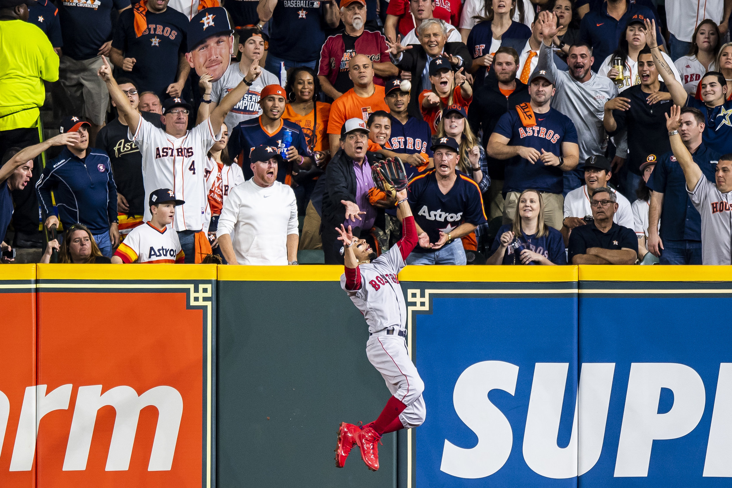 October 18, 2018, Houston, TX: Boston Red Sox outfielder Mookie Betts leaps and robs Houston Astros third basemen Alex Bergman of a home run as the Boston Red Sox face the Houston Astros in Game 5 of the ALCS at Minute Maid Park in Houston, Texas on Thursday, October 18, 2018. (Photo by Matthew Thomas/Boston Red Sox)