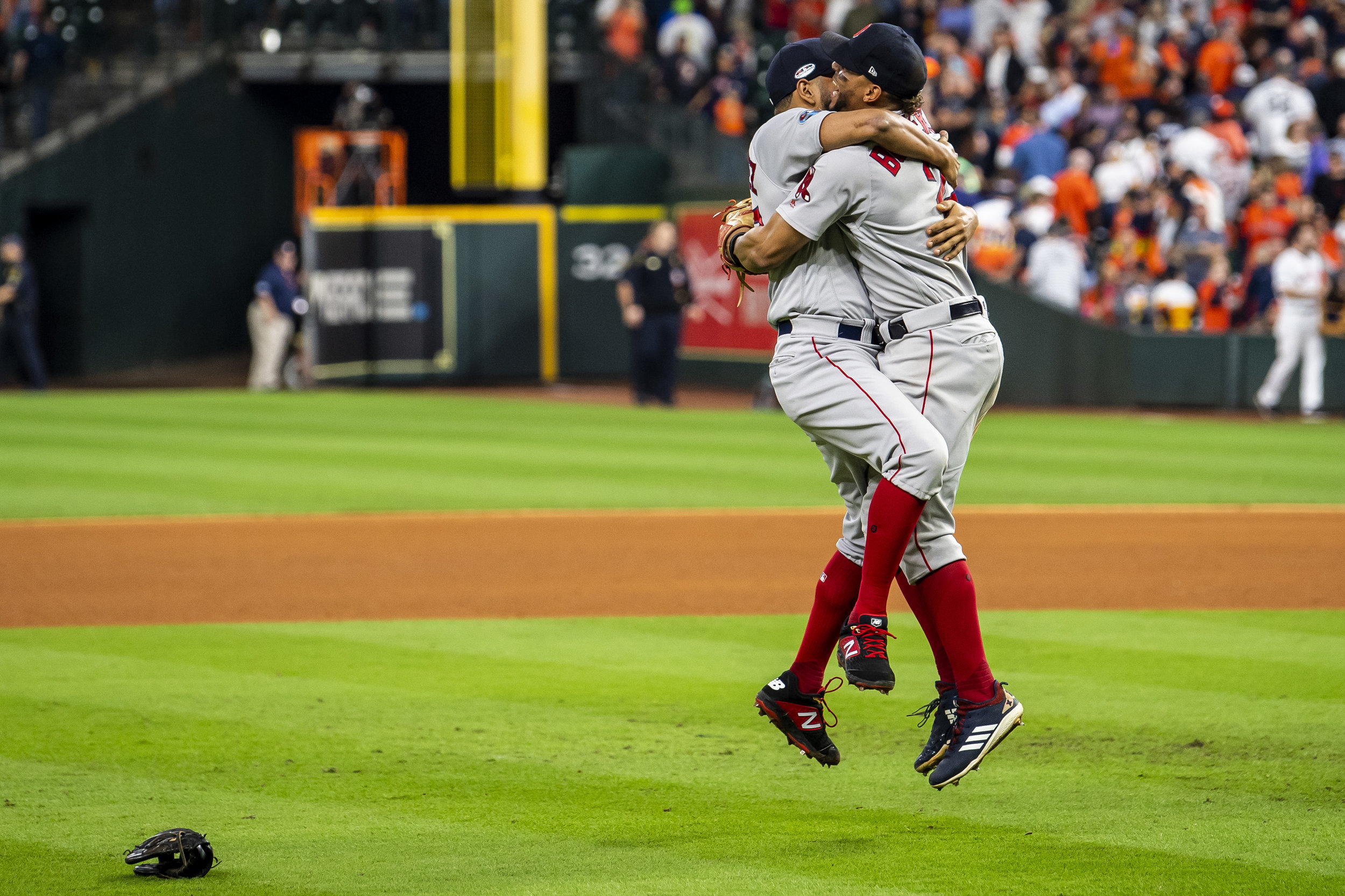 October 18, 2018, Houston, TX: Boston Red Sox shortstop Xander Bogaerts hugs Boston Red Sox pitcher Eduardo Rodriguez after the Boston Red Sox defeated the Houston Astros in Game 5 of the ALCS to advance to the World Series at Minute Maid Park in Houston, Texas on Thursday, October 18, 2018. (Photo by Matthew Thomas/Boston Red Sox)