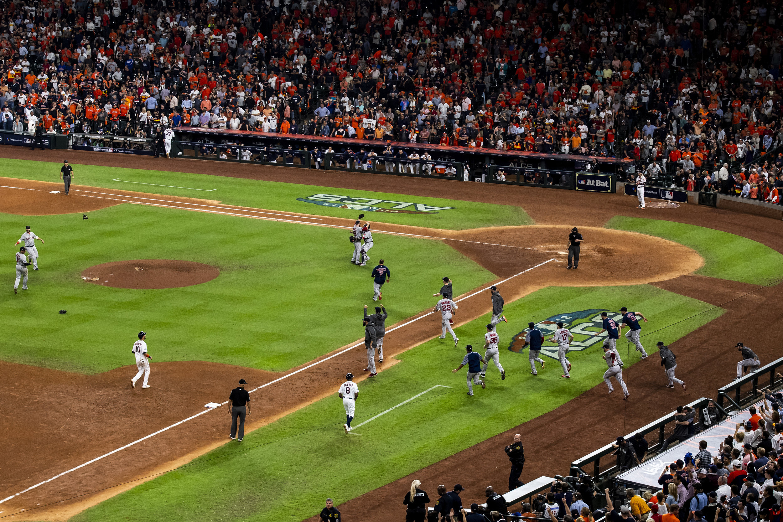 October 18, 2018, Houston, TX: The team rushes onto the field after the Boston Red Sox defeated the Houston Astros in Game 5 of the ALCS to advance to the World Series at Minute Maid Park in Houston, Texas on Thursday, October 18, 2018. (Photo by Matthew Thomas/Boston Red Sox)