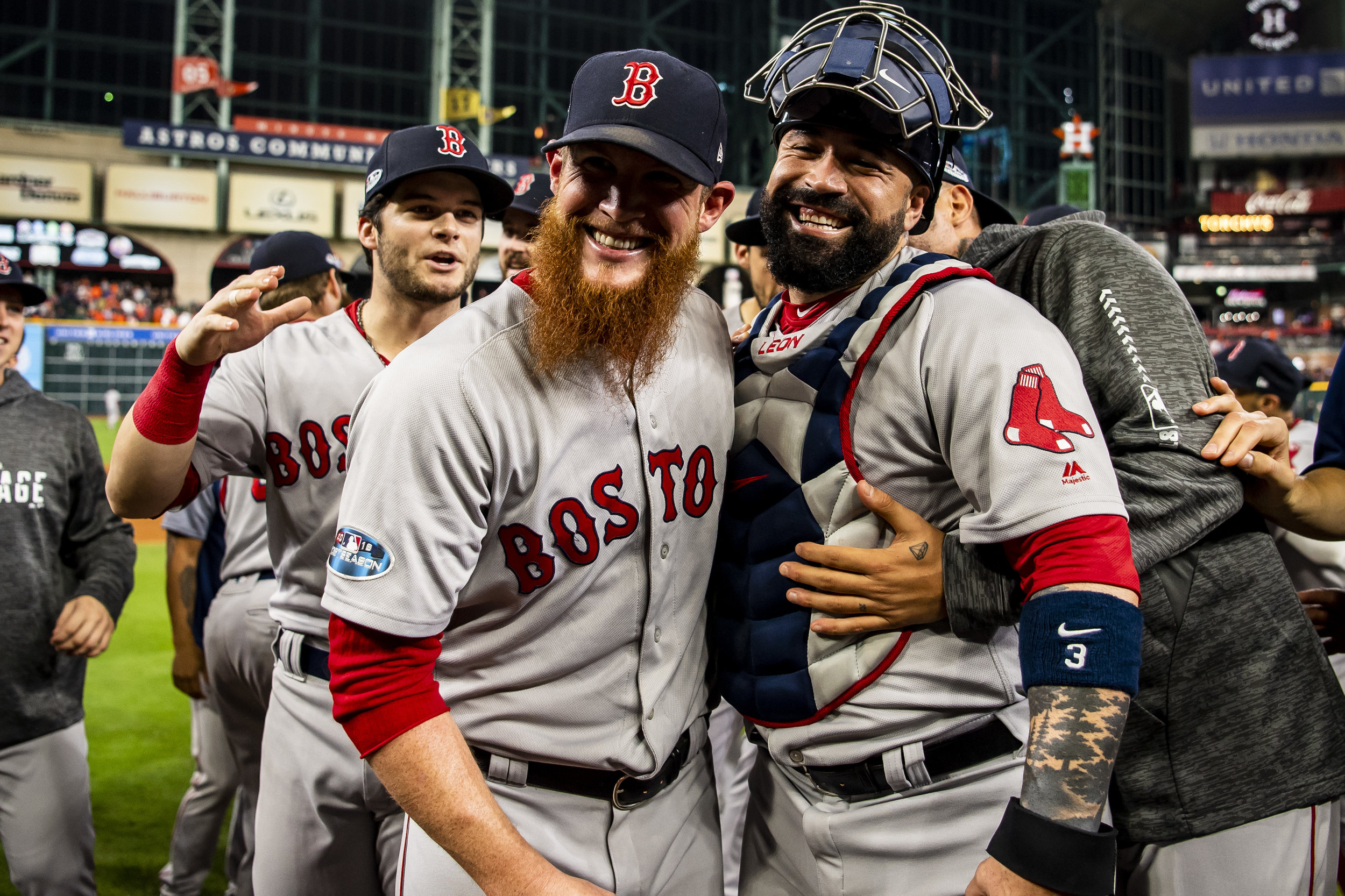 October 18, 2018, Houston, TX: Boston Red Sox pitcher Craig Kimbrel hugs Boston Red Sox catcher Sandy Leon after the Boston Red Sox defeated the Houston Astros in Game 5 of the ALCS to advance to the World Series at Minute Maid Park in Houston, Texas on Thursday, October 18, 2018. (Photo by Matthew Thomas/Boston Red Sox)