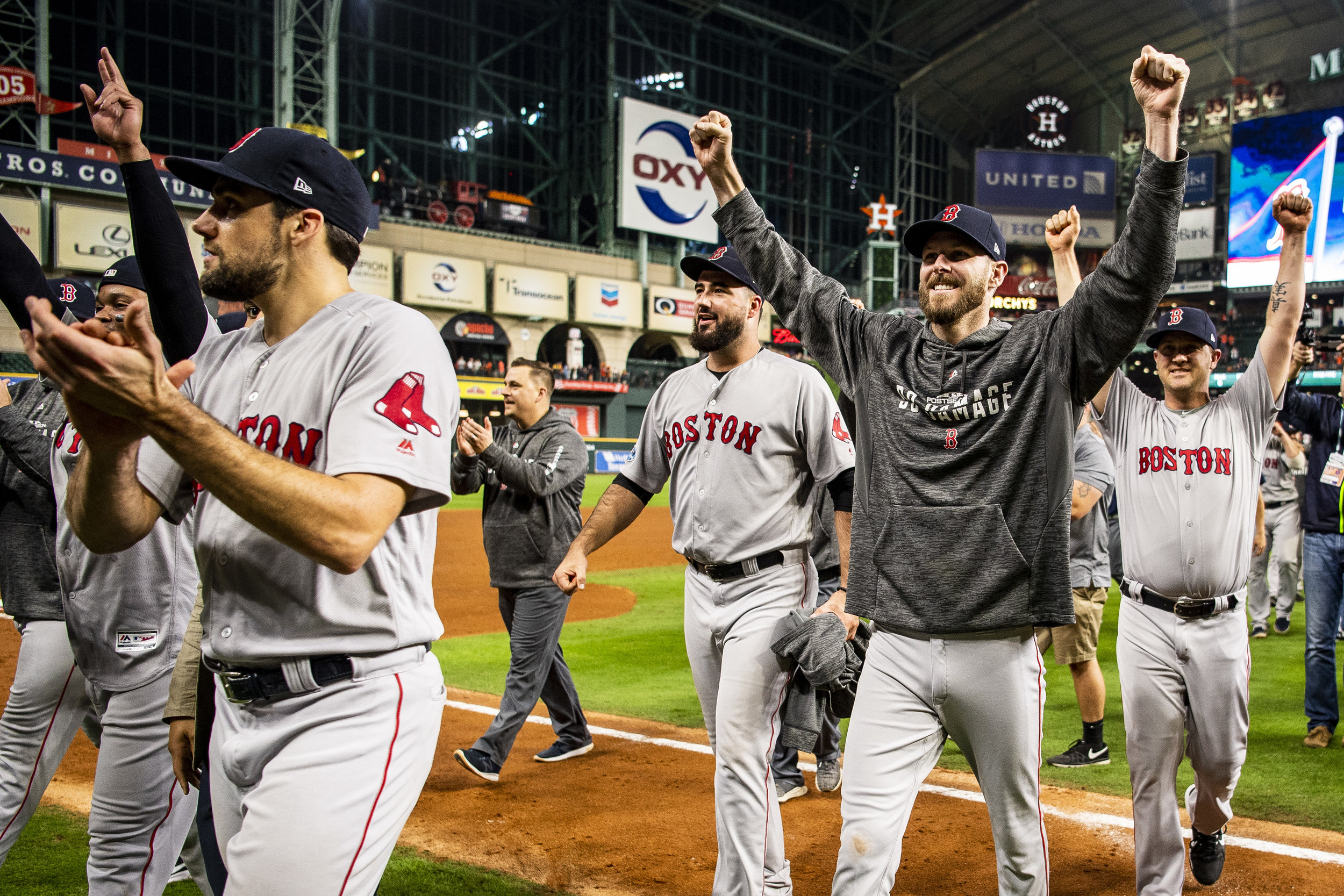 October 18, 2018, Houston, TX: The Boston Red Sox raise their hands as they walk off the field after defeating the Houston Astros in Game 5 of the ALCS to advance to the World Series at Minute Maid Park in Houston, Texas on Thursday, October 18, 2018. (Photo by Matthew Thomas/Boston Red Sox)