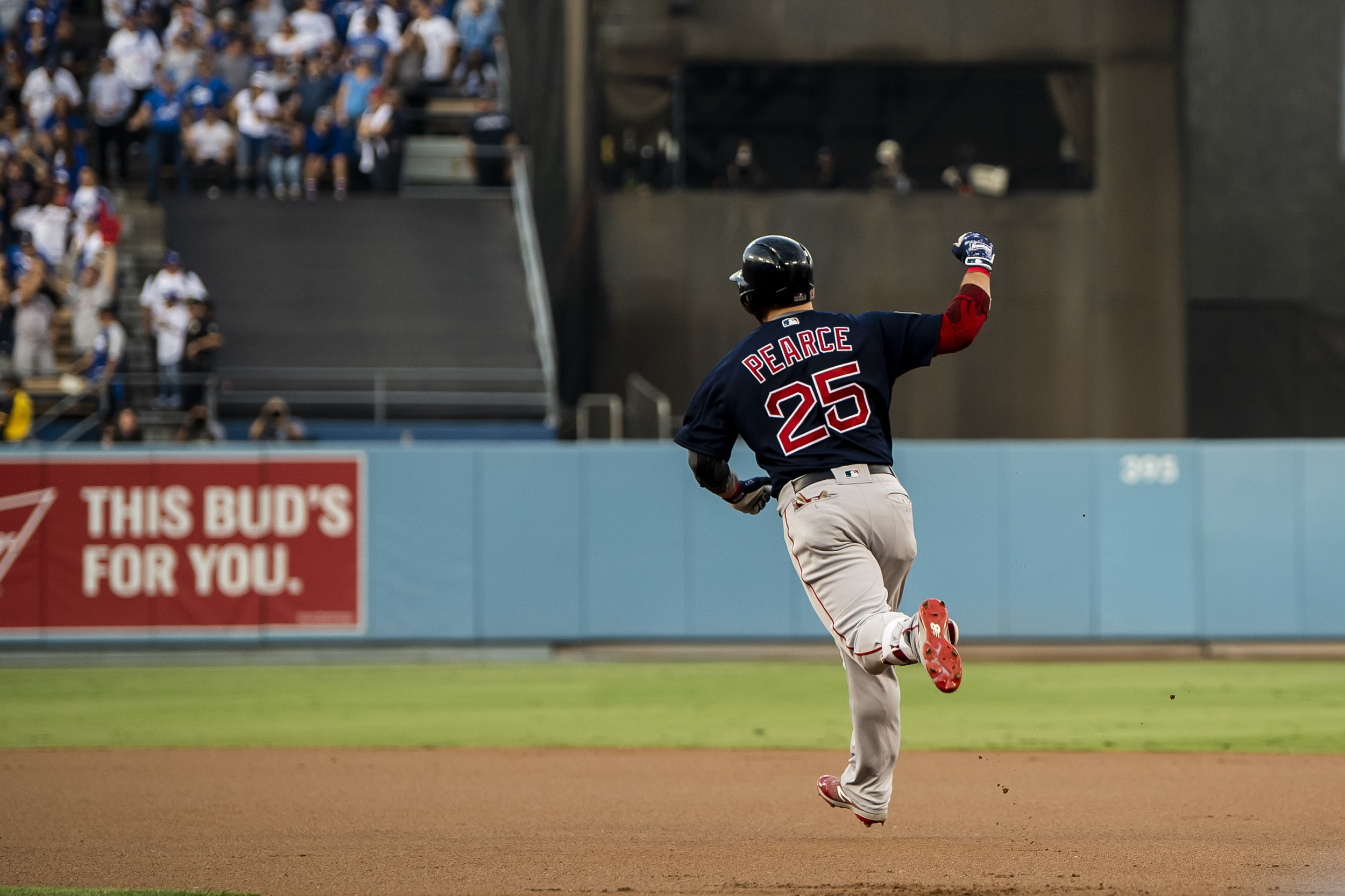October 28, 2018, Los Angeles, Ca: Boston Red Sox infielder Steve Pearce raises his fist after hitting a home run as the Boston Red Sox face the Los Angeles Dodgers in Game 5 of the World Series at Dodger Stadium in Los Angeles, California on Saturday, October 28, 2018. (Photo by Matthew Thomas/Boston Red Sox)