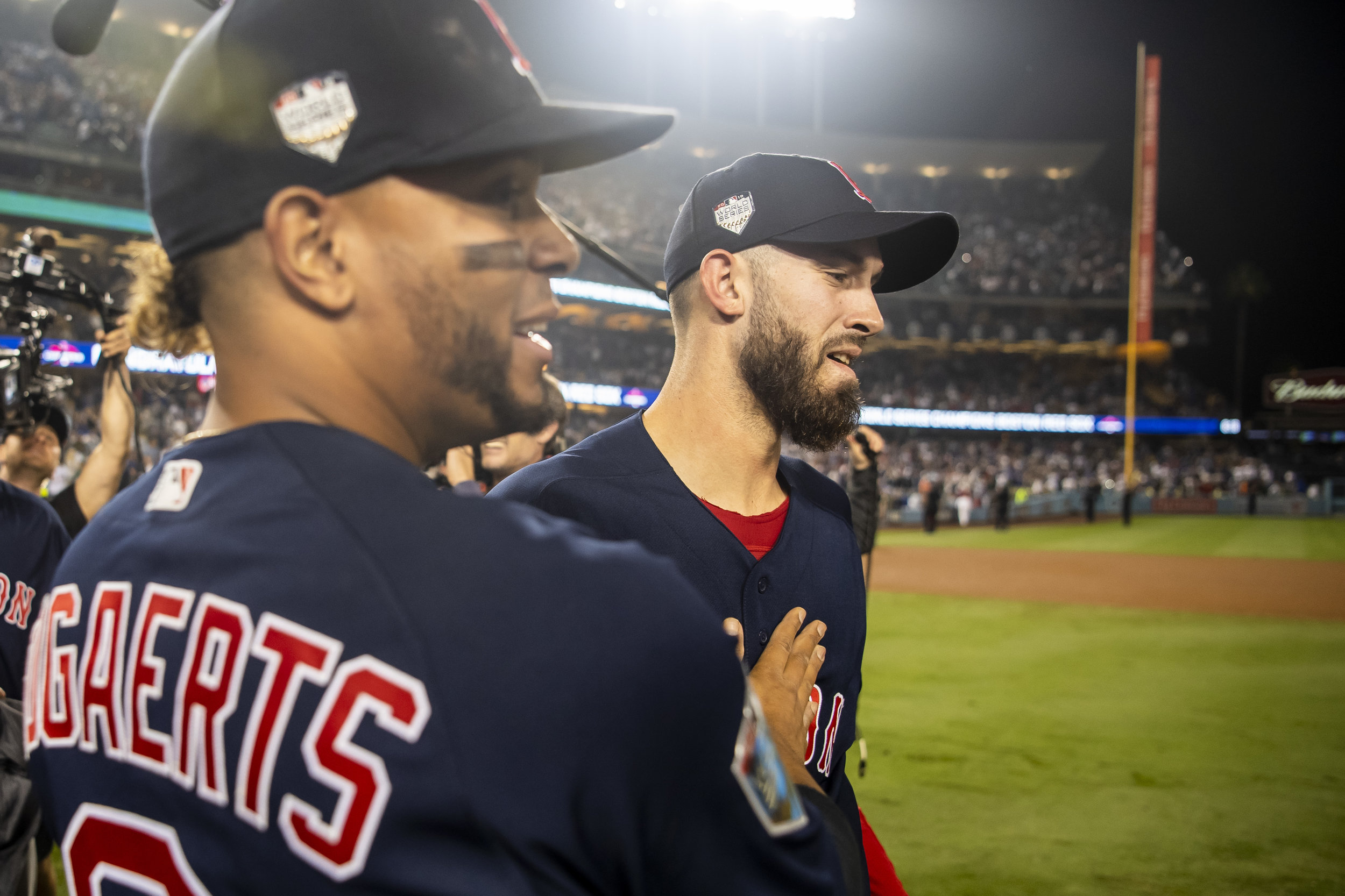October 28, 2018, Los Angeles, Ca: Boston Red Sox shortstop Xander Bogaerts pats Boston Red Sox pitcher Rick Porcello's chest after the Boston Red Sox defeated the Los Angeles Dodgers in Game 5 to win the World Series at Dodger Stadium in Los Angeles, California on Saturday, October 28, 2018. (Photo by Matthew Thomas/Boston Red Sox)