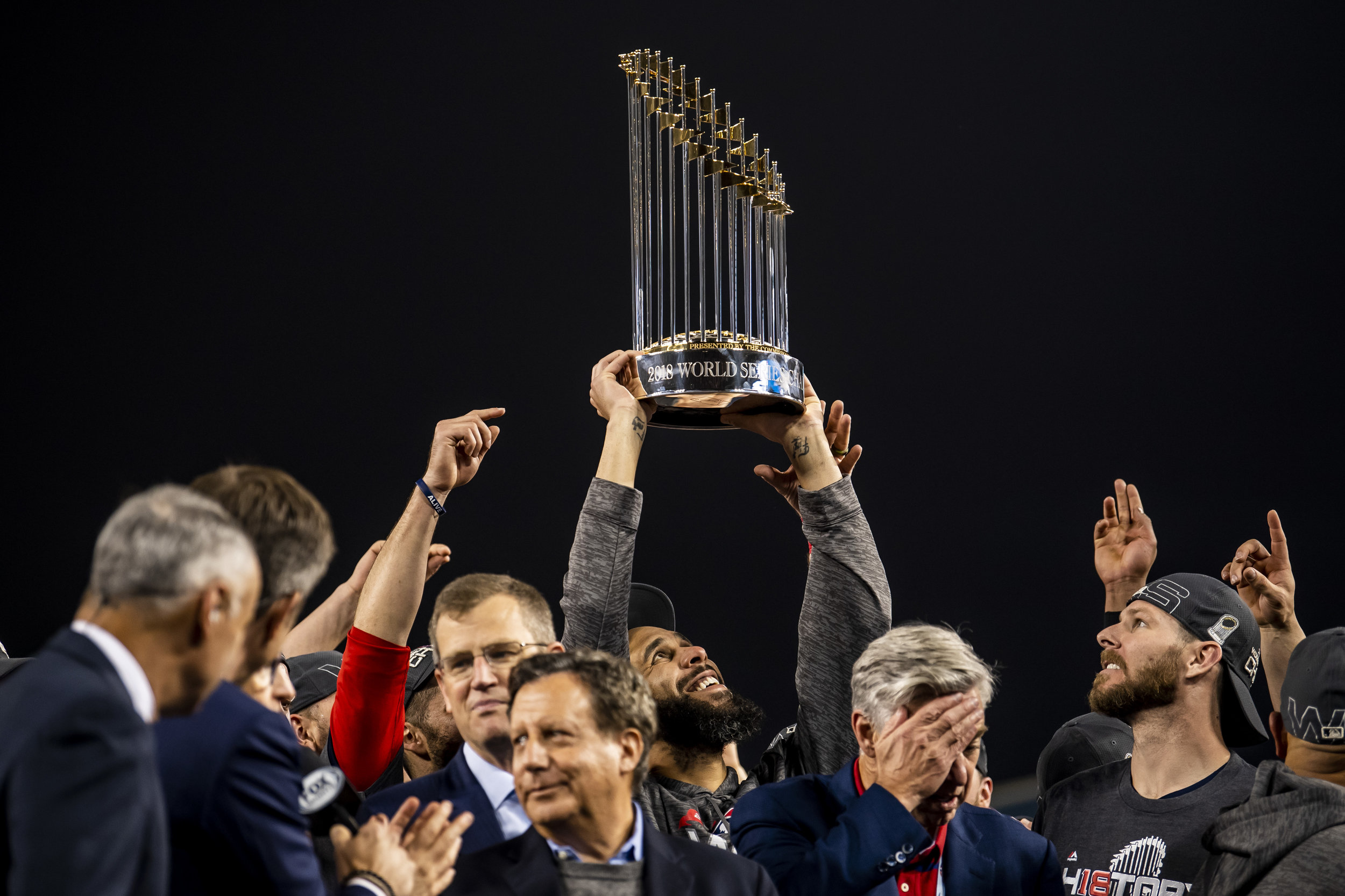 October 28, 2018, Los Angeles, Ca: Boston Red Sox pitcher David Price holds up the World Series Trophy after the Boston Red Sox defeated the Los Angeles Dodgers in Game 5 to win the World Series at Dodger Stadium in Los Angeles, California on Saturday, October 28, 2018. (Photo by Matthew Thomas/Boston Red Sox)