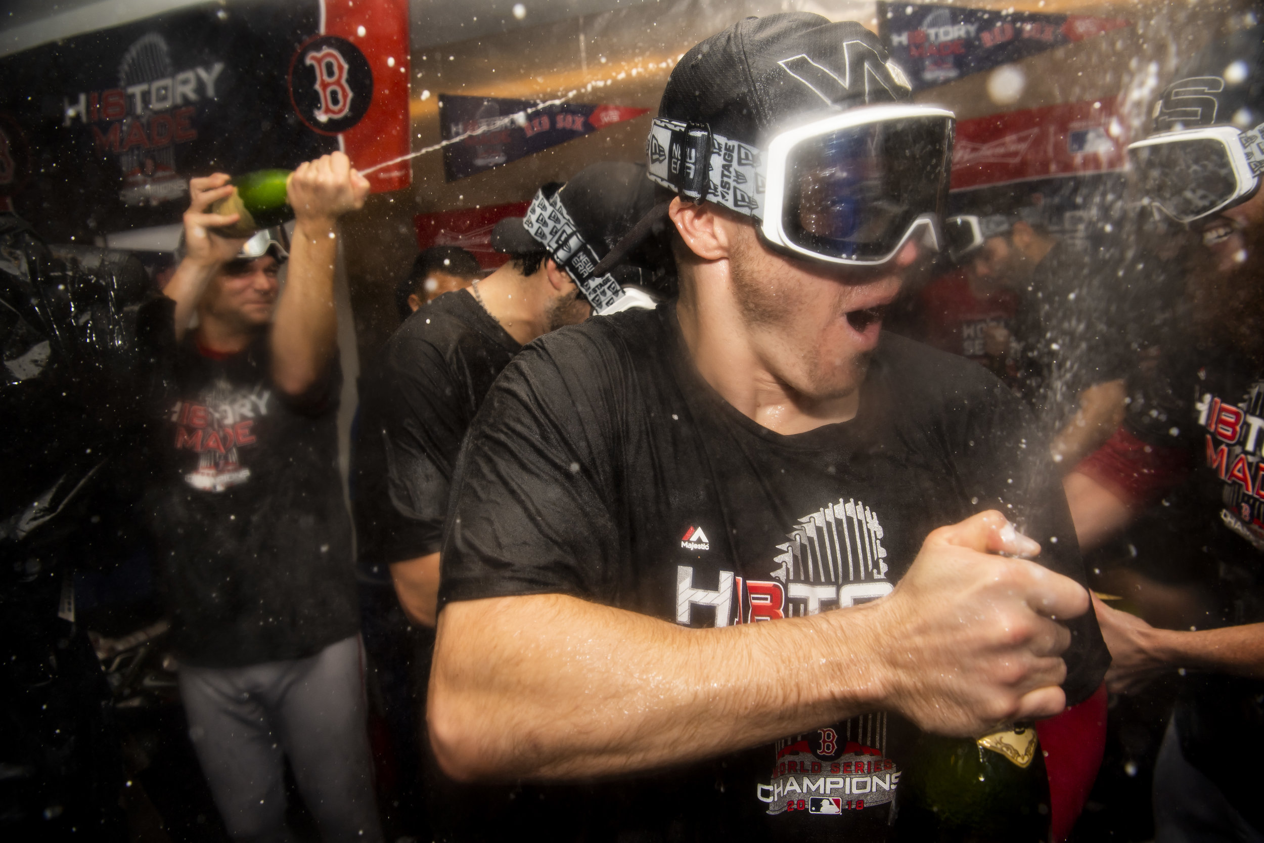 October 28, 2018, Los Angeles, Ca: Boston Red Sox infielder Brock Holt sprays champagne after the Boston Red Sox defeated the Los Angeles Dodgers in Game 5 to win the World Series at Dodger Stadium in Los Angeles, California on Saturday, October 28, 2018. (Photo by Matthew Thomas/Boston Red Sox)