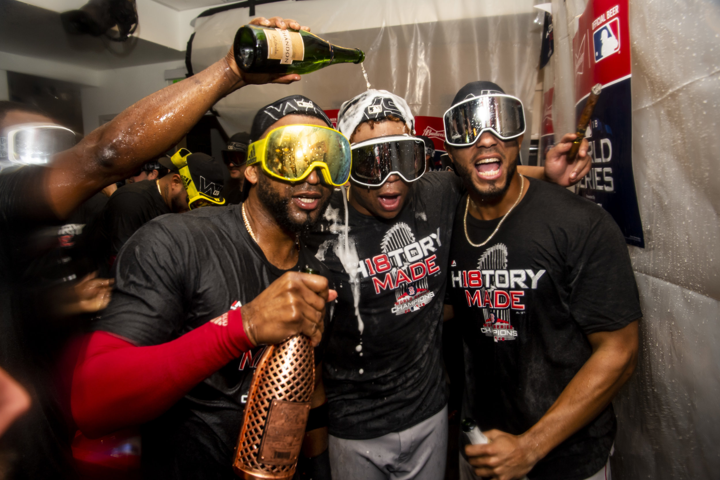 October 28, 2018, Los Angeles, Ca: Boston Red Sox second basemen Eduardo Nunez, Boston Red Sox third basemen Rafael Devers and Boston Red Sox shortstop Xander Bogaerts celebrate after the Boston Red Sox defeated the Los Angeles Dodgers in Game 5 to win the World Series at Dodger Stadium in Los Angeles, California on Saturday, October 28, 2018. (Photo by Matthew Thomas/Boston Red Sox)