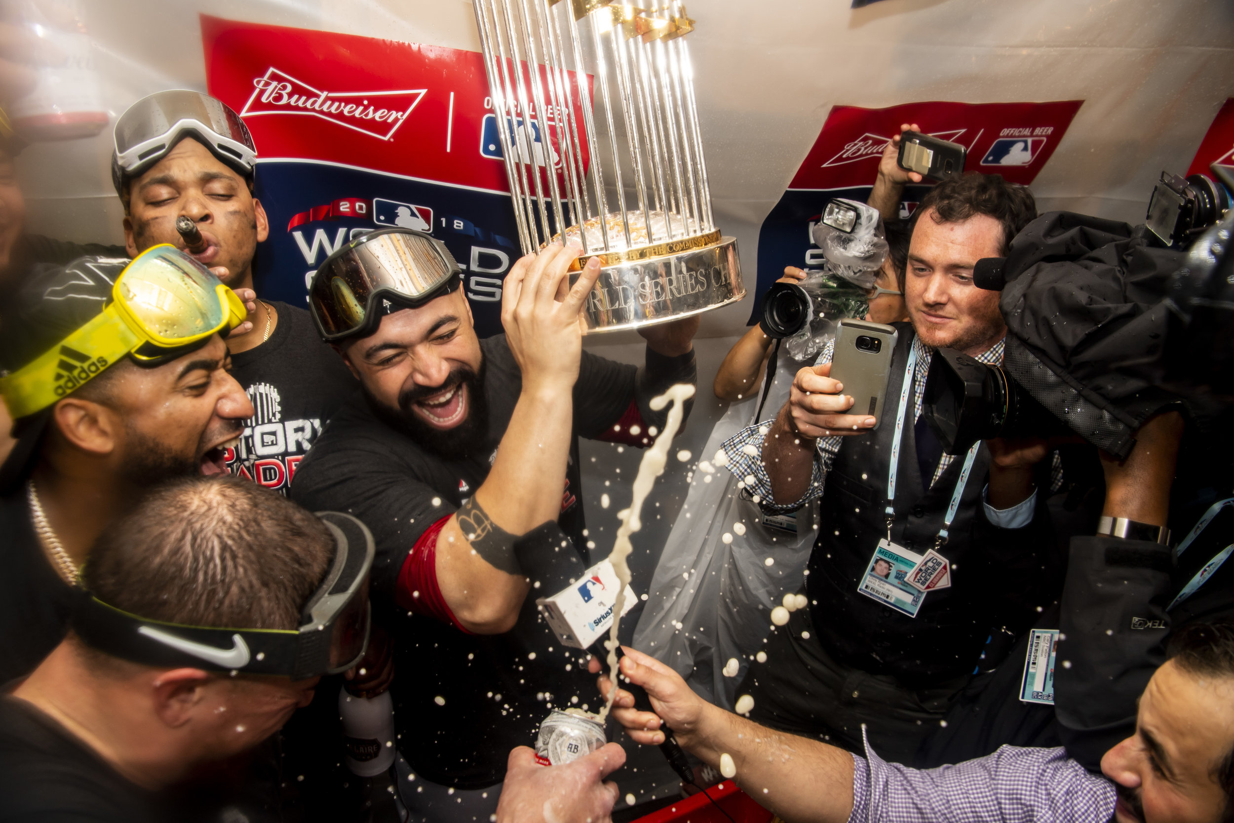 October 28, 2018, Los Angeles, Ca: Boston Red Sox catcher Sandy Leon holds up the World Series Trophy after the Boston Red Sox defeated the Los Angeles Dodgers in Game 5 to win the World Series at Dodger Stadium in Los Angeles, California on Saturday, October 28, 2018. (Photo by Matthew Thomas/Boston Red Sox)