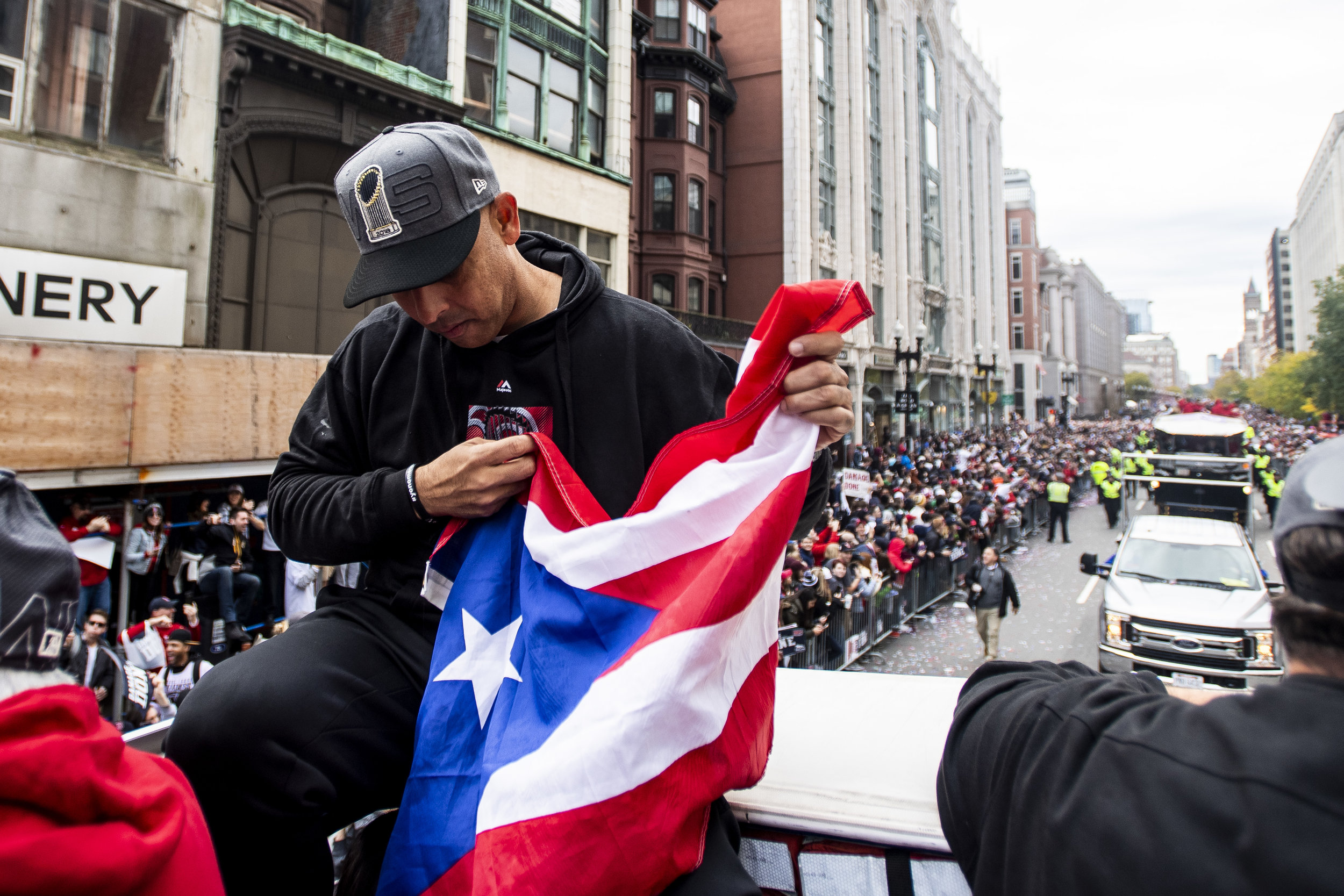 October 31, 2018, Boston, MA: Boston Red Sox Manager Alex Cora looks down at the Puerto Rican flag  as the Red Sox Celebrate the World Series Parade in Boston, Massachusetts on Wednesday, October 31, 2018. (Photo by Matthew Thomas/Boston Red Sox)