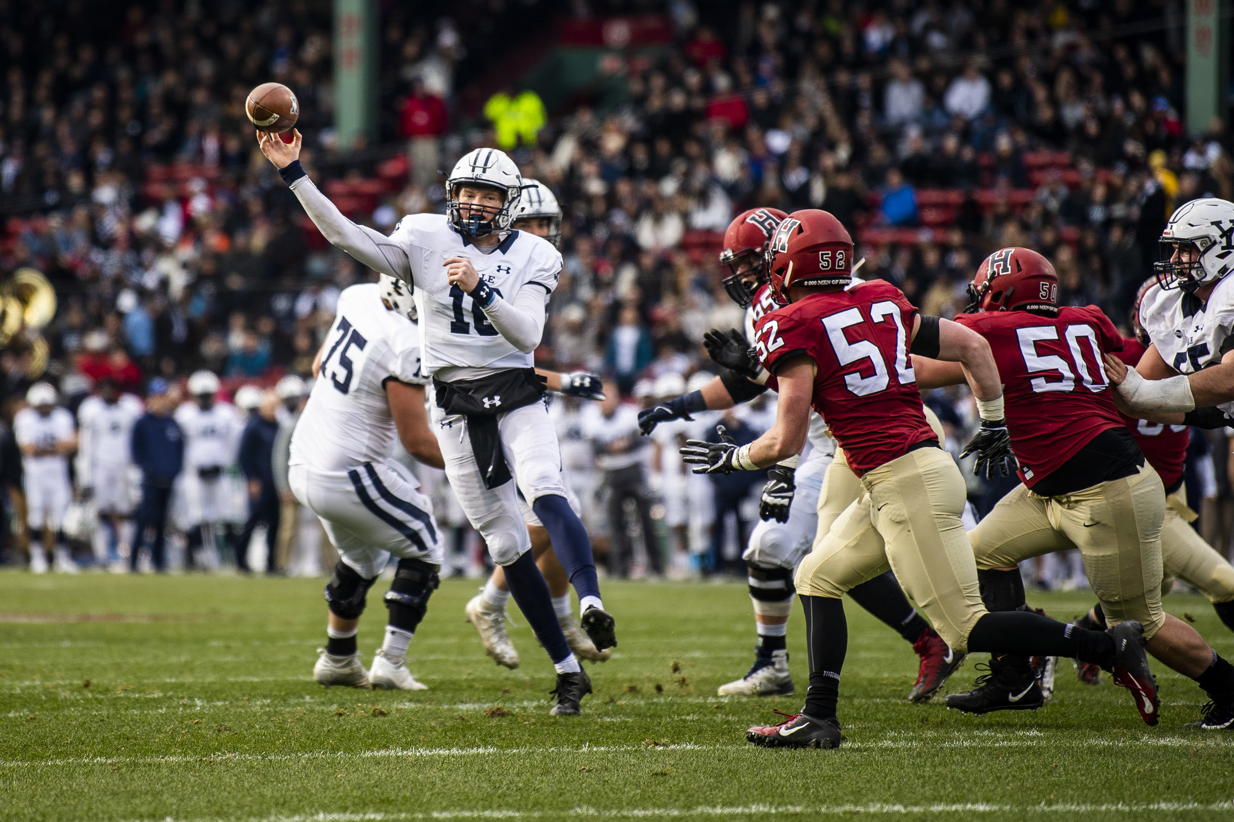 November 16, 2018, Boston, MA: A Yale football player throws the ball during the Harvard University and Yale University football Game at Fenway Park in Boston, Massachusetts on Thursday, November 16, 2018. (Photo by Matthew Thomas/Boston Red Sox)
