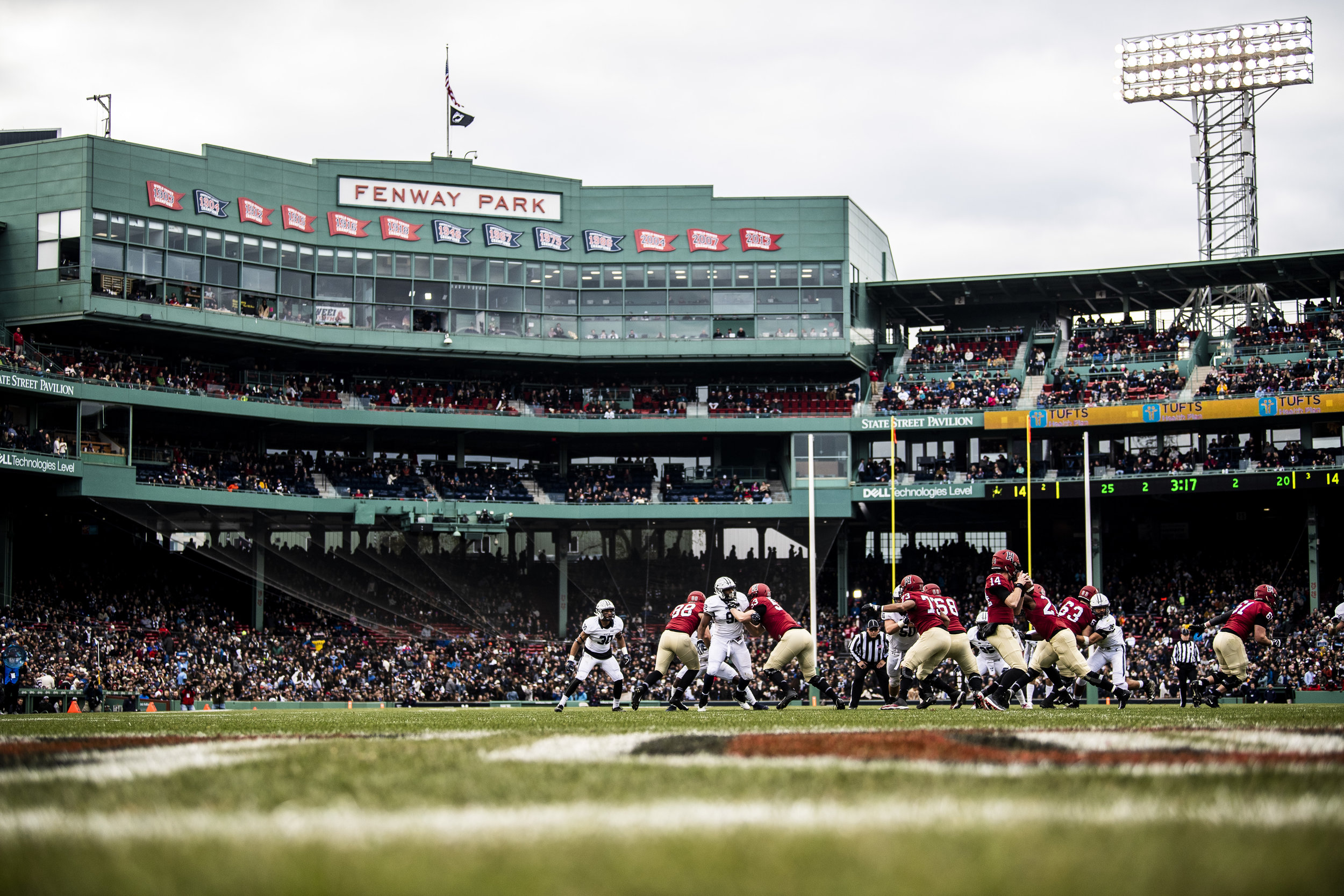 November 16, 2018, Boston, MA: A Harvard Player makes a throw during the Harvard University and Yale University football Game at Fenway Park in Boston, Massachusetts on Thursday, November 16, 2018. (Photo by Matthew Thomas/Boston Red Sox)
