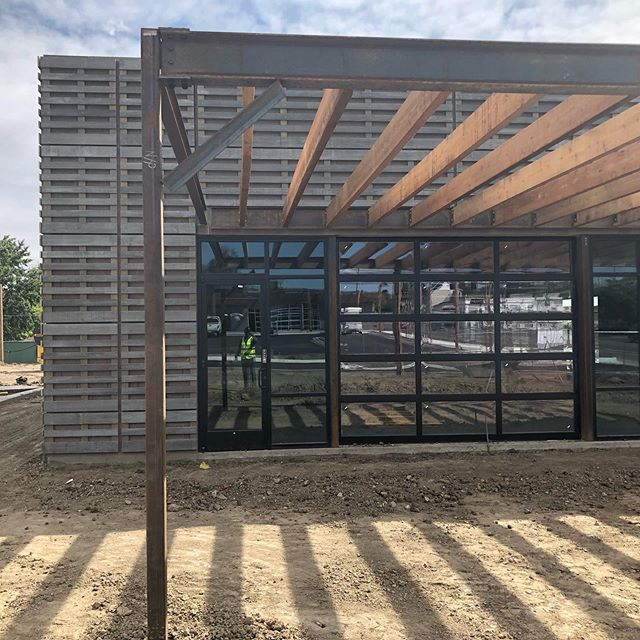 A few preview images of building 4 @edgewaterpublicmarket which is clad in weathered Acoya laid out in a pallet pattern.  The building features an awesome exterior #mural and exterior patios with overhead trellis. #meridian105architecture #edgewater #denver #woodsiding #restaurant #weathered