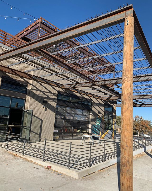 The rebar trellis is being installed over the large patio at the Edgewater Public Market. #edgewater #meridian105architecture #trellis #rebar #patio #denver #timber