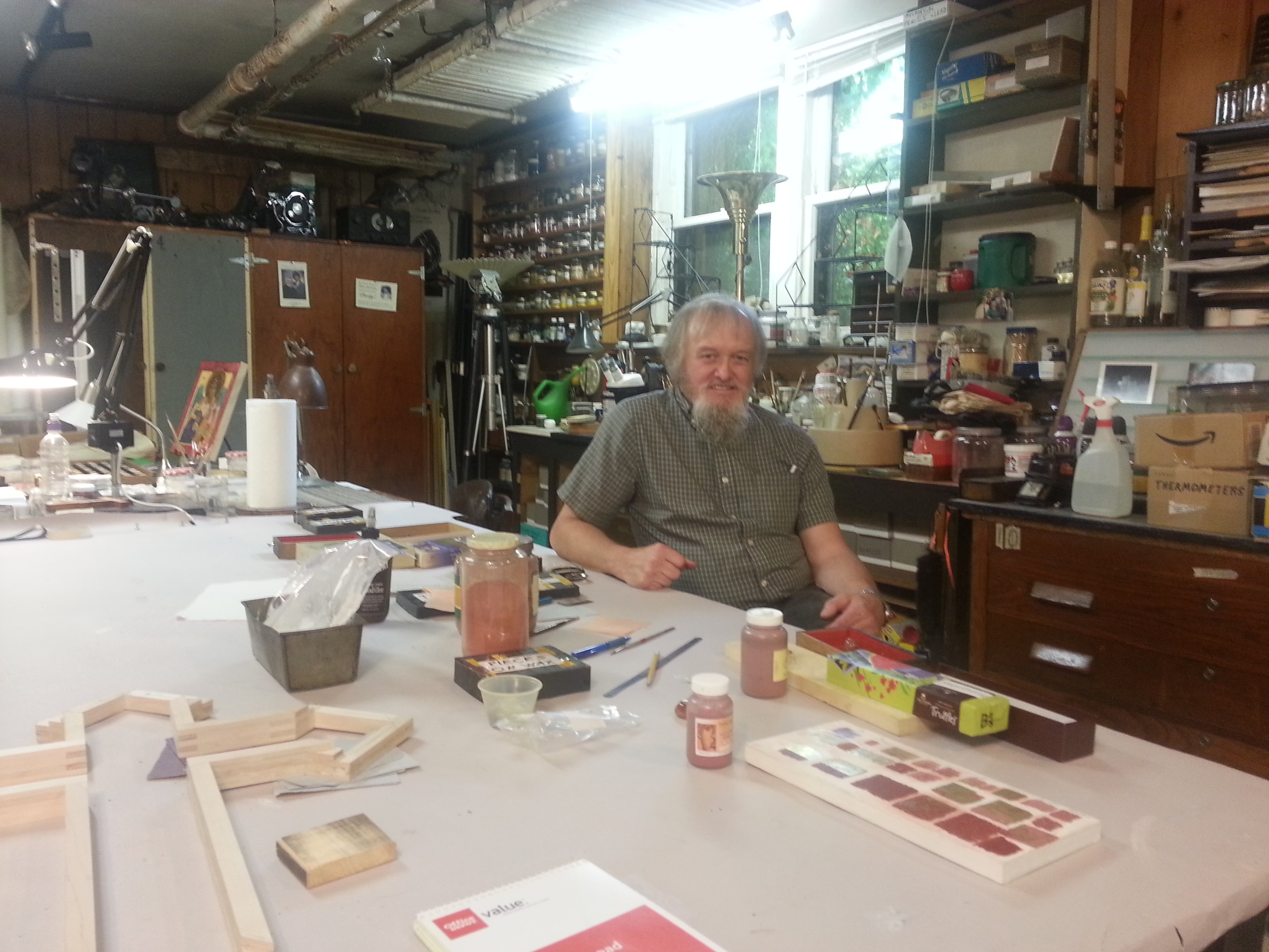 The artists David Abel Johnson showing me how to apply gold leaf