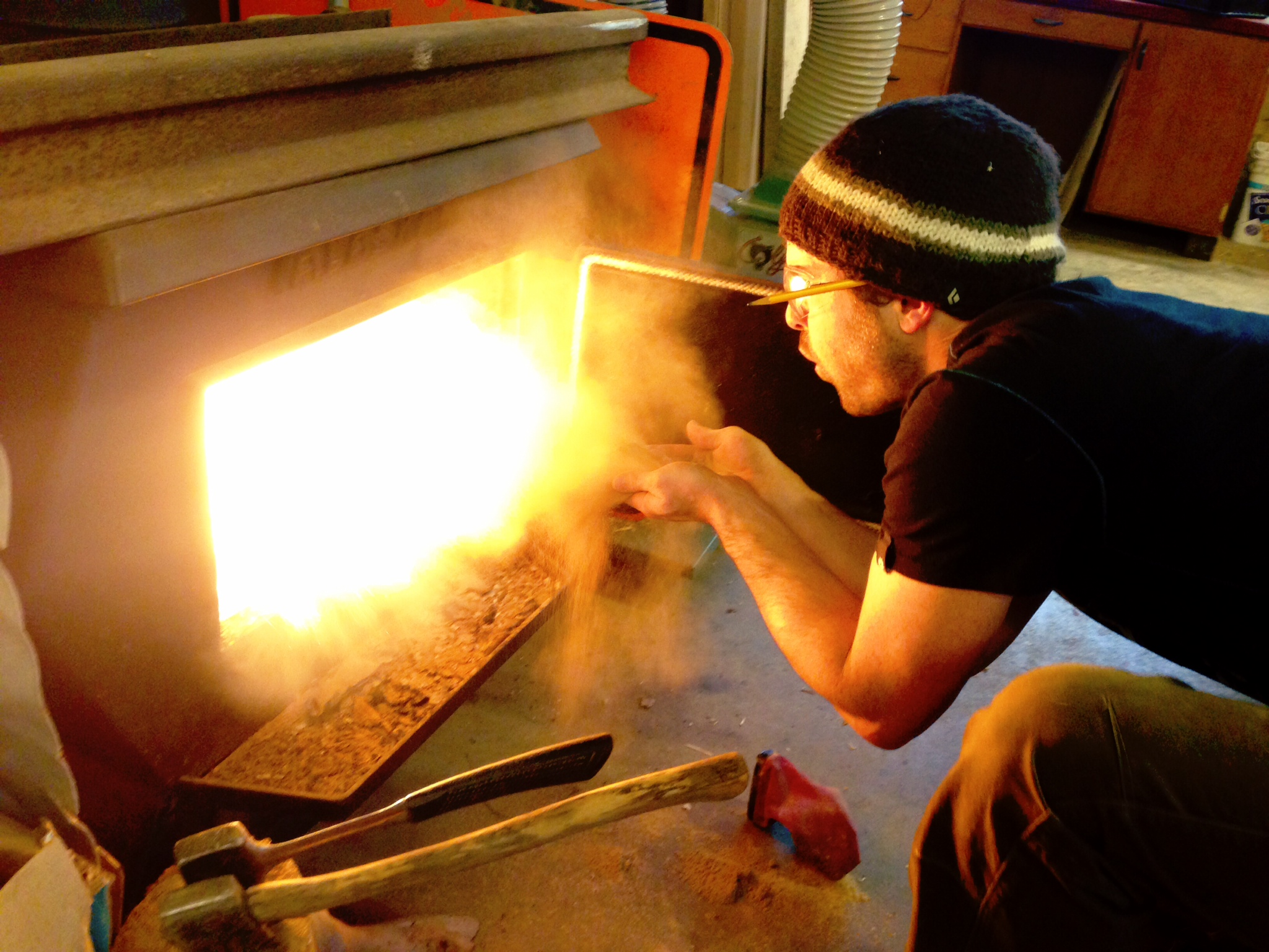 Fueling the woodshop fire with a blast of fine sawdust.