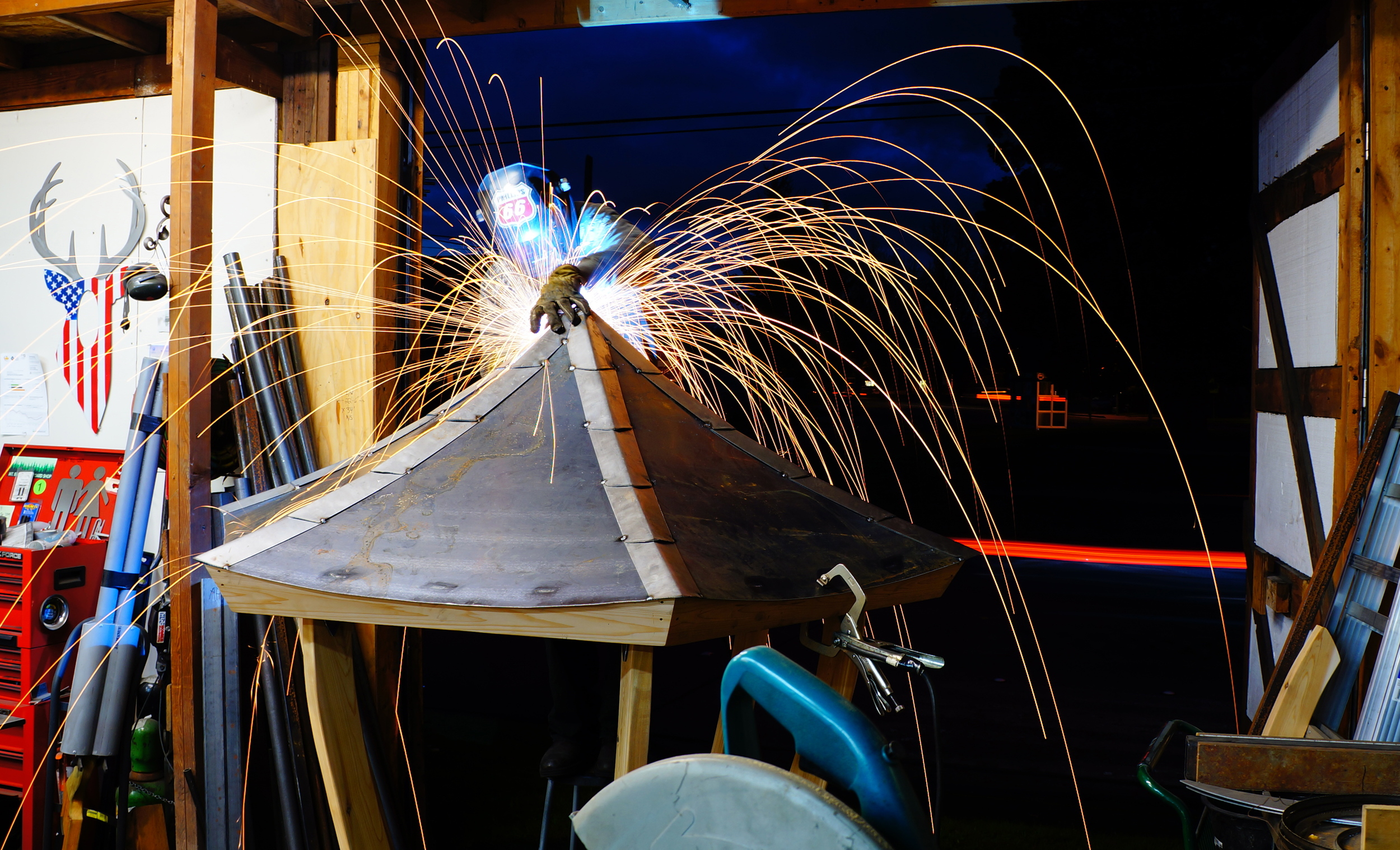 Andy Phillips of Blackfin Design welding the roof panels of the Prayer Wheel Pagoda.