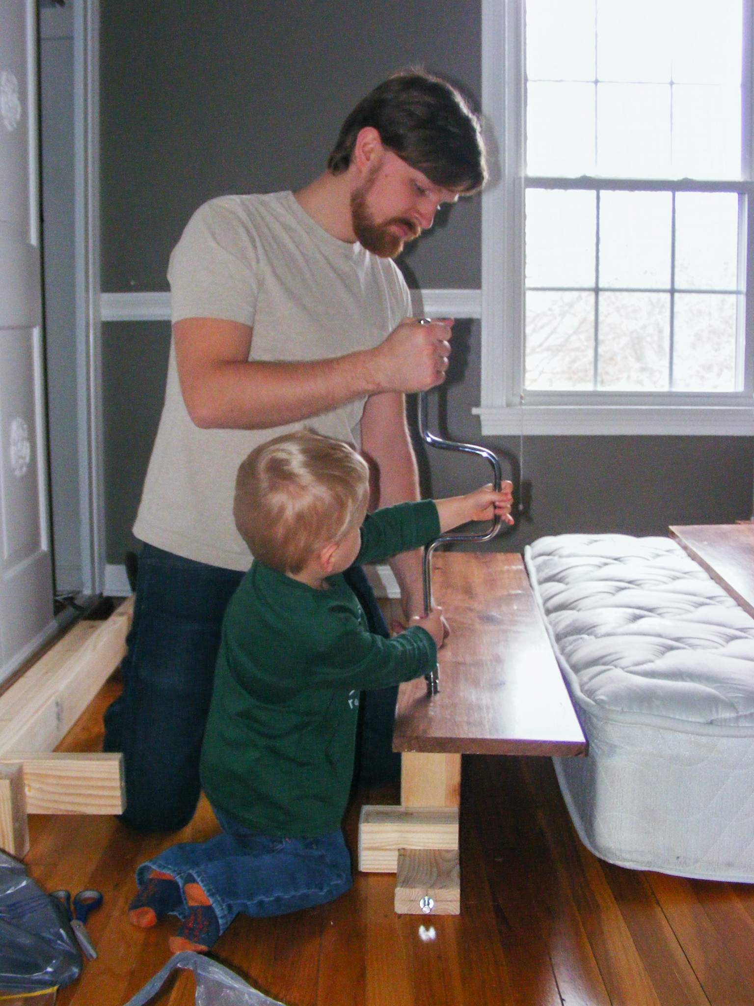 Elias helped me attach the foot board to the rail assembly.
