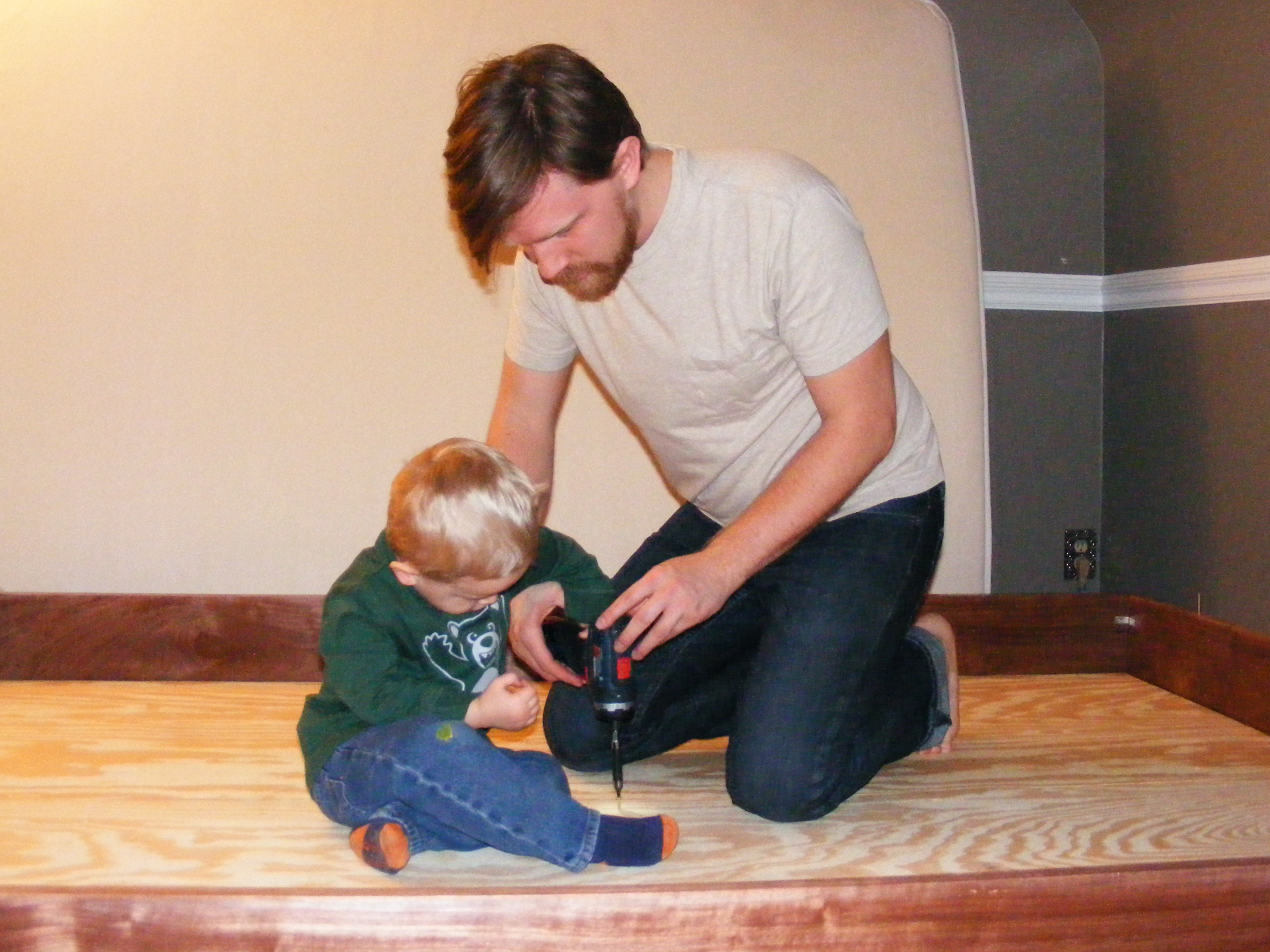 Elias helped me drive the last screw attaching the plywood to the bed frame.