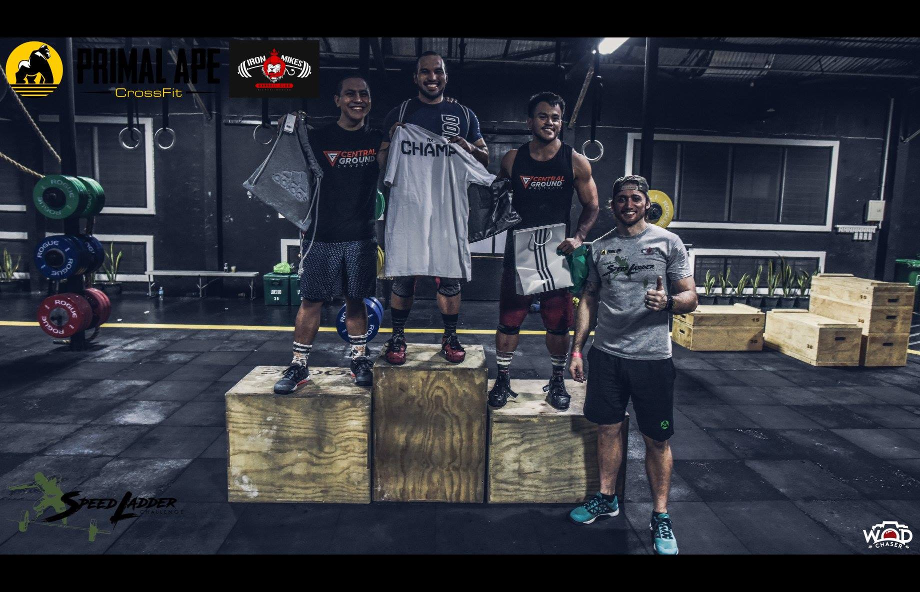 Jude Eslera hailed as the Champ of the Clean and Jerk - Men's RX, followed by Job Wi (left pulpit)and Benny Ledesma (right pulpit). Coach Trever Love, head coach of Primal Ape CrossFit. (Photo: WOD Chaser)