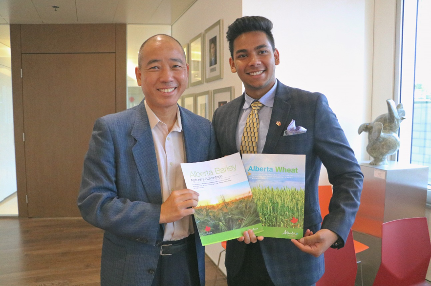 Arnav Jain (right) photographed with Houston Wong (left), Trade Commissioner of Agriculture and Agri-Food, at the Canadian Consulate in Hong Kong.