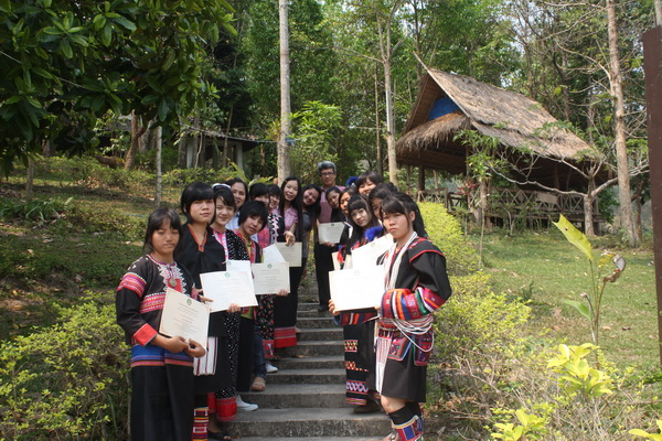 Students in traditional dress receiving their cerificates