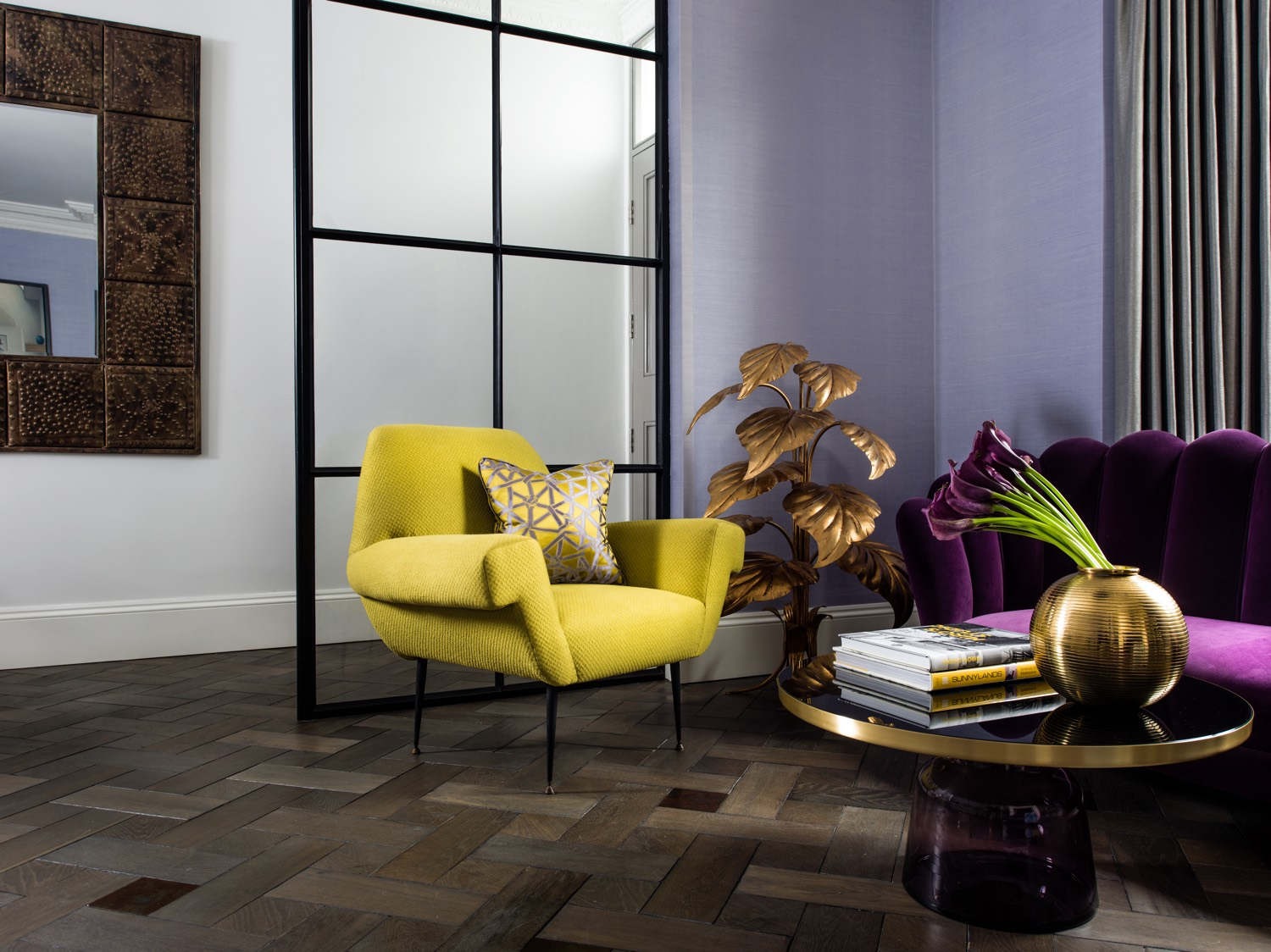Smoked oak flooring in a basket weave pattern with metal accents, Critall Window partition separates the Reception Room from the front entrance. Vintage Chair, Lamp and Loveseat add retro glamour.