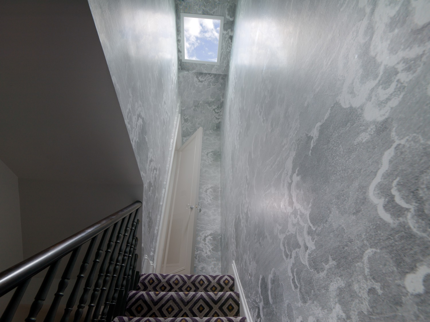 Stairway to Heaven, or the Master Bedroom suite. Custom Carpet and Fornasetti wall paper.