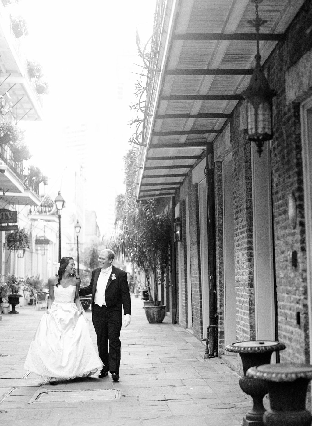 Wedding Planning | New Orleans Wedding | French Quarter Wedding | Sapphire Events | Ryan Ray Photography | White and Green Wedding | Formal Black Tie Wedding | Monique Lhuillier Dress | tux with tails | black tie wedding | architecture | french quarter | bridal portrait