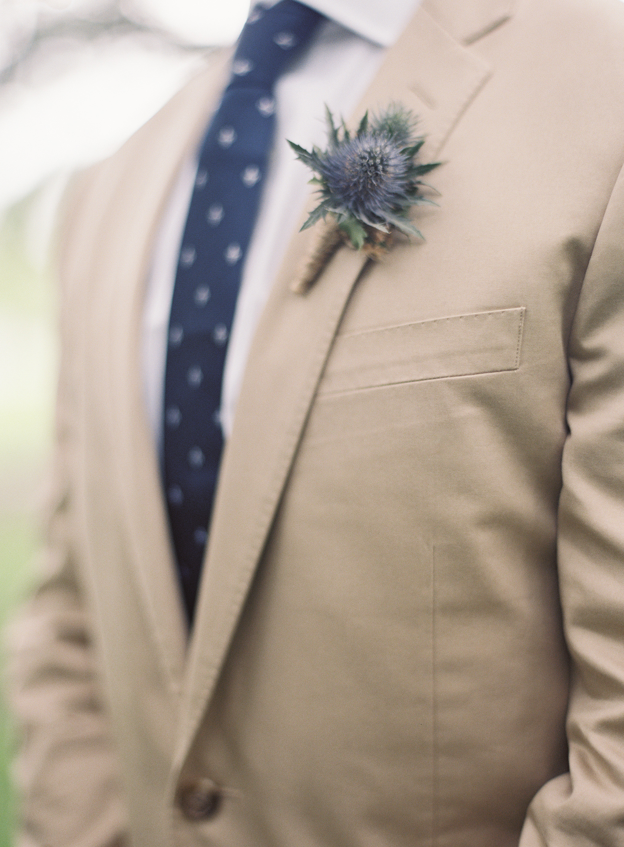 Sapphire Events | Catherine Guidry Photography | Wedding Planning | New Orleans Wedding | Stella Plantation Wedding | Blue and White Wedding | Classic Rainy Day Wedding | Outdoor Wedding | Tent Wedding | Hunter Boots | Blue and White Wedding Details | Blue Thistle Boutonniere