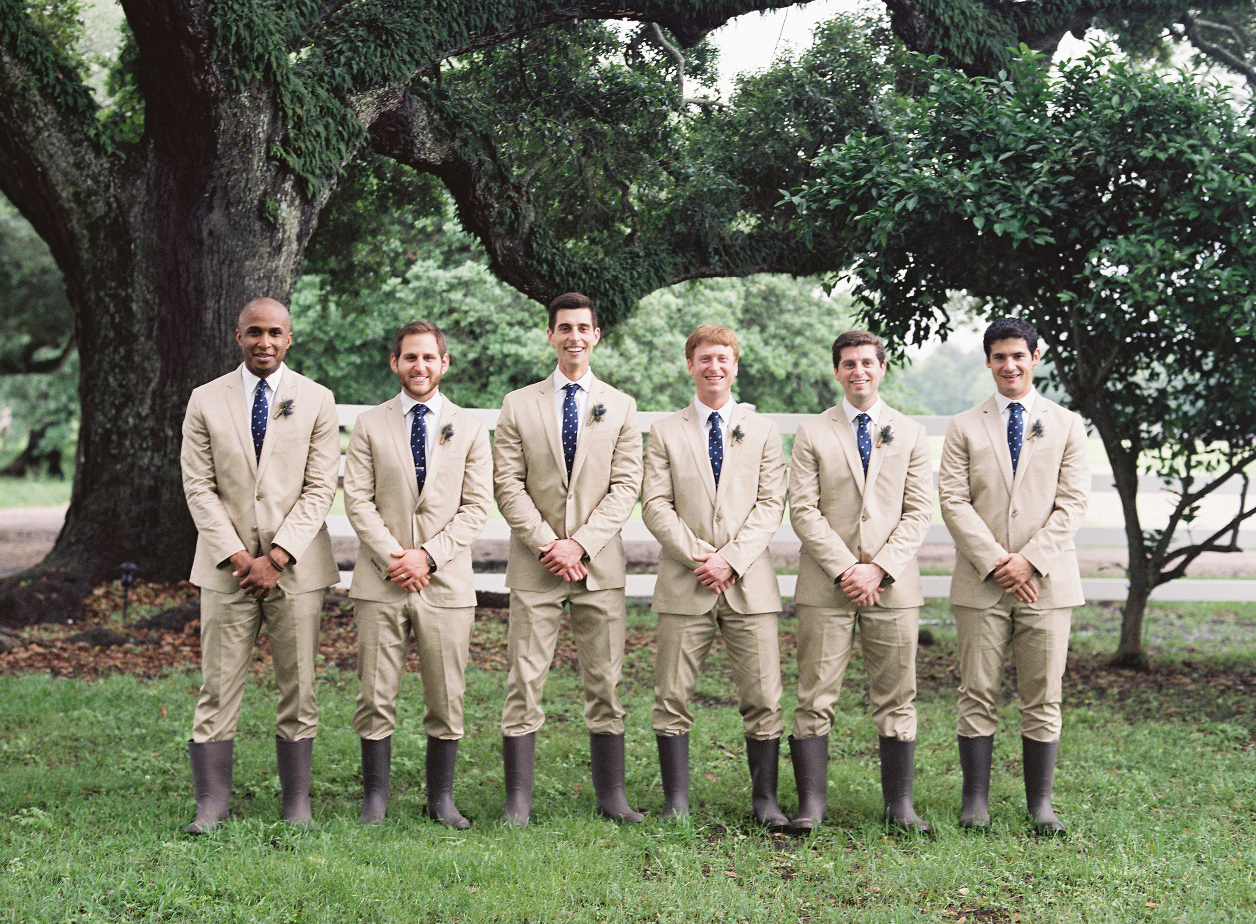 Sapphire Events | Catherine Guidry Photography | Wedding Planning | New Orleans Wedding | Stella Plantation Wedding | Blue and White Wedding | Classic Rainy Day Wedding | Outdoor Wedding | Tent Wedding | Hunter Boots | Blue and White Wedding Details | tan suits groomsmen | rain boots