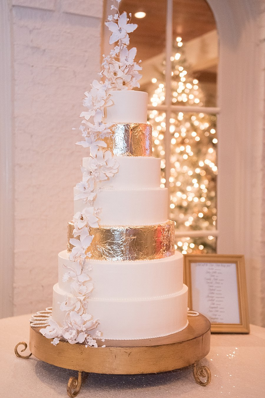 La Louisiane Bakery | Gold foil Cake | Classic black and white black-tie wedding at home | Sapphire Events | Jacqueline Dallimore Photo | NYE Wedding | Estate Wedding | Tented Wedding | Monique Lhuillier gown | Blush Wedding dress | New Year's Eve wedding
