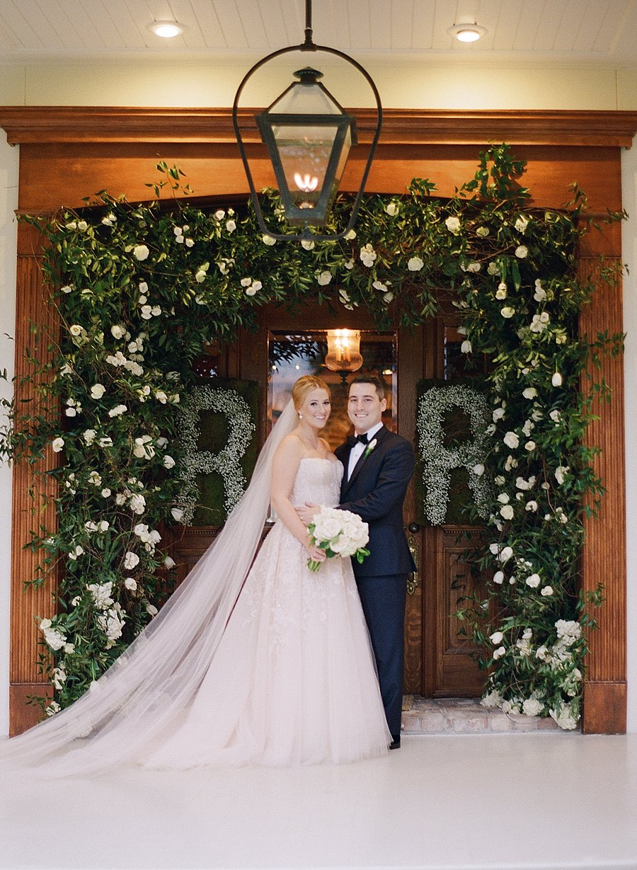 Kim Starr Wise florals | Classic black and white black-tie wedding at home | Sapphire Events | Jacqueline Dallimore Photo | NYE Wedding | Estate Wedding | Tented Wedding | Monique Lhuillier gown | Blush Wedding dress | New Year's Eve wedding