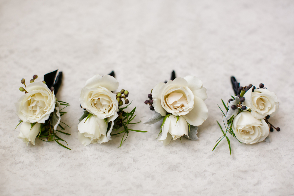 Kim Starr Wise florals | Winter white boutonnieres | How to transform an open ballroom with stunning decor | Sapphire Events | Greer G Photography | Board of Trade | White and Gold Wedding | Winter Wedding Inspiration | White and Green Wedding | Ballroom wedding