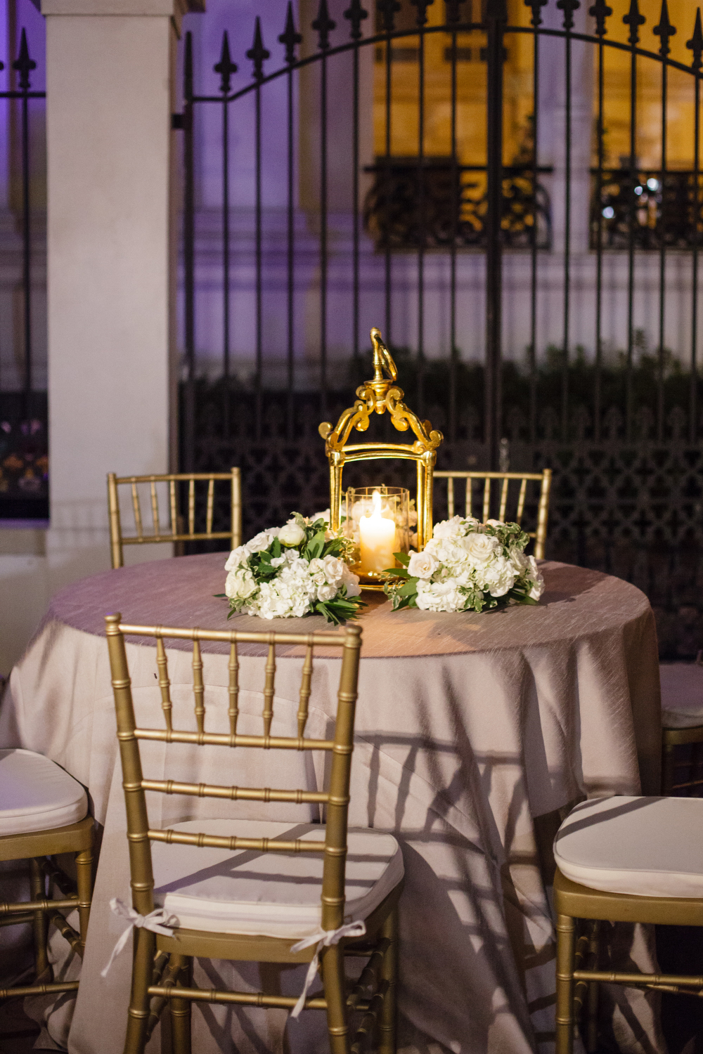 Courtyard cocktail hour decorations | Gold French lanterns | How to transform an open ballroom with stunning decor | Sapphire Events | Greer G Photography | Board of Trade | White and Gold Wedding | Winter Wedding Inspiration | White and Green Wedding | Ballroom wedding