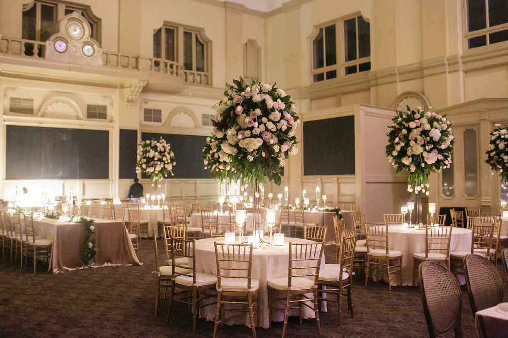 How to transform an open ballroom with stunning decor | Sapphire Events | Greer G Photography | Board of Trade | White and Gold Wedding | Winter Wedding Inspiration | White and Green Wedding | Ballroom wedding | tall green and white centerpieces | mix of round and long tables
