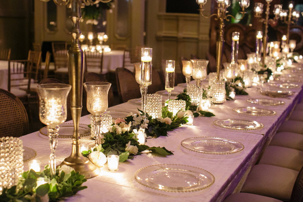 How to transform an open ballroom with stunning decor | Sapphire Events | Greer G Photography | Board of Trade | White and Gold Wedding | Winter Wedding Inspiration | White and Green Wedding | Ballroom wedding | long table floral garland
