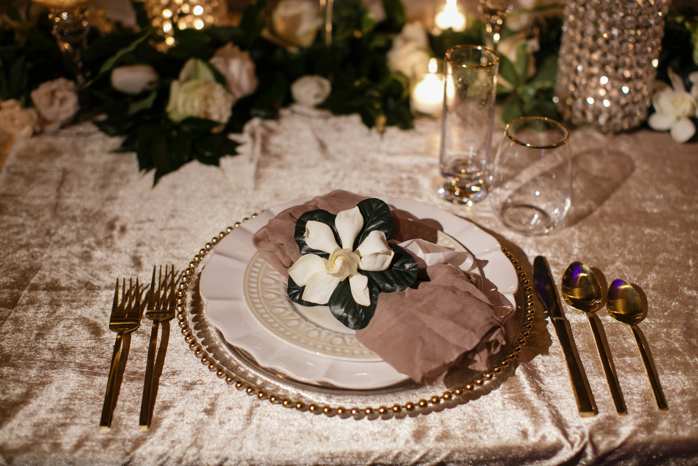 Gardenia place setting | How to transform an open ballroom with stunning decor | Sapphire Events | Greer G Photography | Board of Trade | White and Gold Wedding | Winter Wedding Inspiration | White and Green Wedding | Ballroom wedding