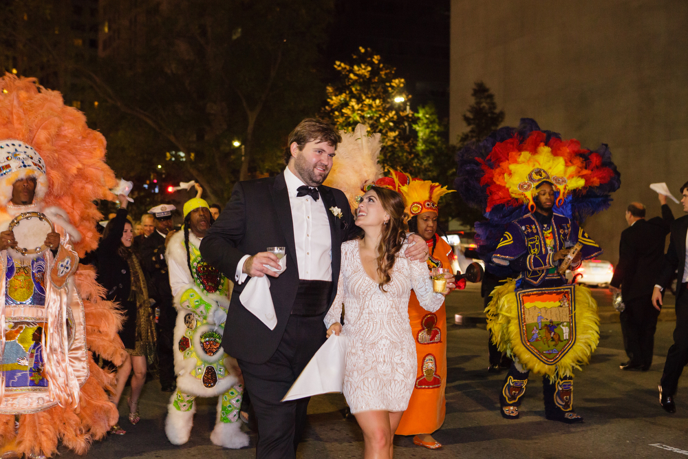 Mardi Gras Indian leading second line parade | How to transform an open ballroom with stunning decor | Sapphire Events | Greer G Photography | Board of Trade | White and Gold Wedding | Winter Wedding Inspiration | White and Green Wedding | Ballroom wedding