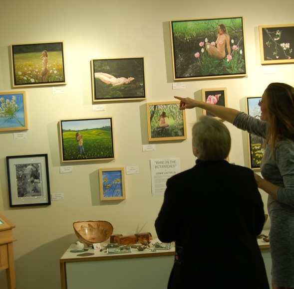 Debbie discussing her pieces at the show opening at Summer Island Studio on December 13, 2014.
