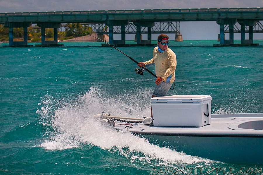 chasing down a fish in sloppy seas, the big yeti helps keep the angler on board. nikon d300s, 80mm, f/4.5, 1/4000 sec