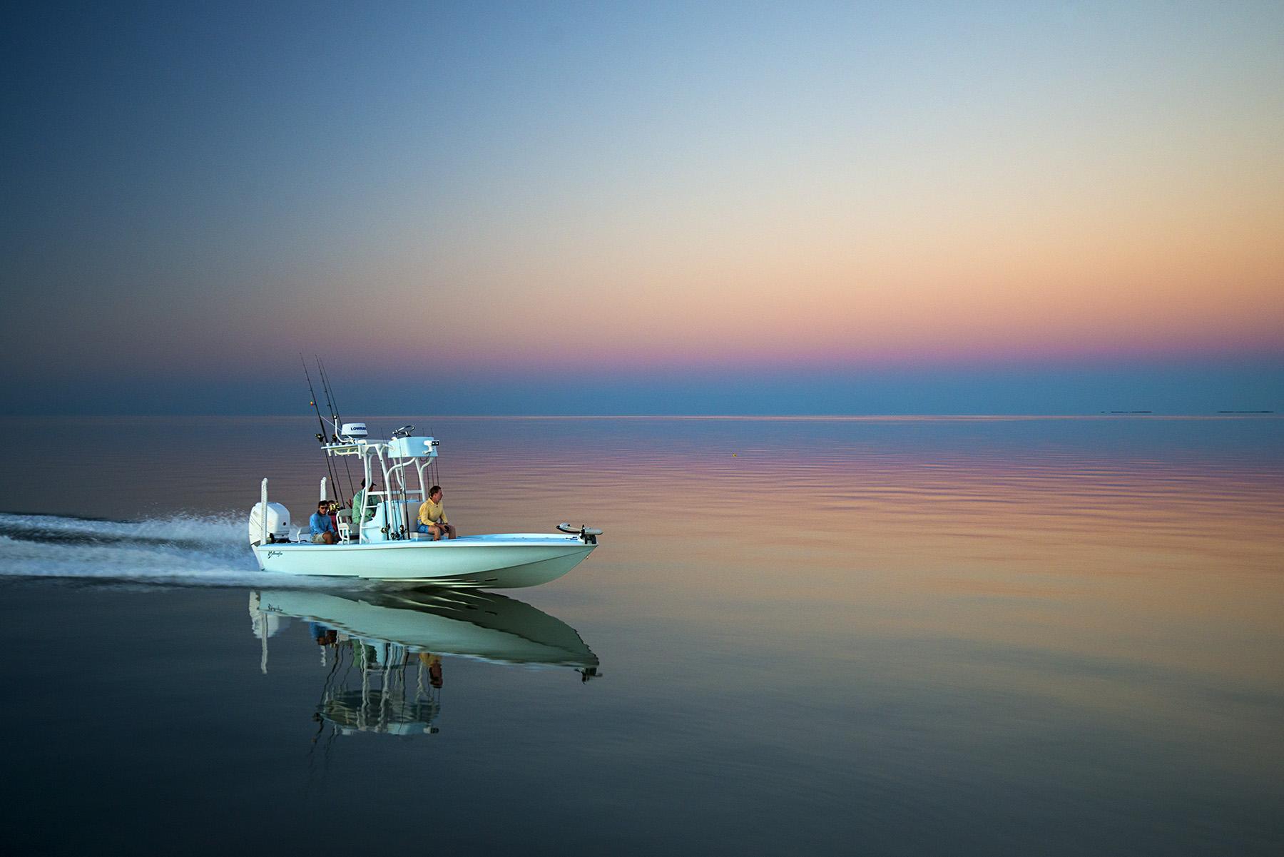 The Yellowfin 24 Bay Boat with Mercury 300 Verado running through Florida Bay at sunset