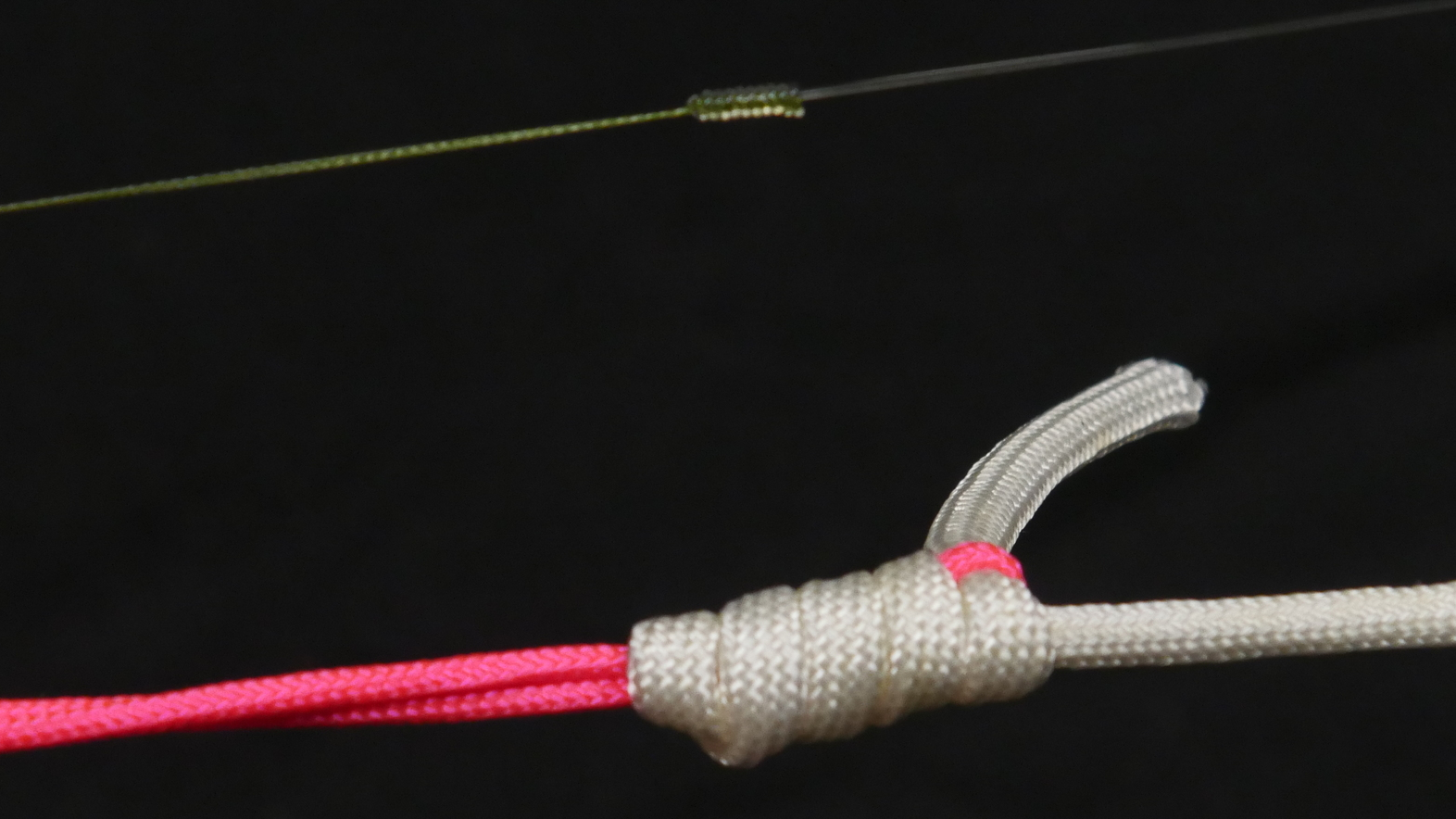 The Aussie Quickie Knot for braid to fluorocarbon shown above with braid and fluorocarbon and below with heavy cord