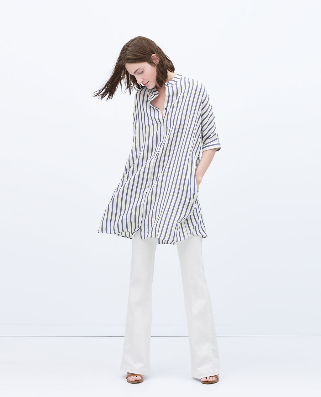 Being the ultimate baggybutton-down, you can nevergo wrong here! This piece can be worn as a shirt or dress with a cool feel & casual look.