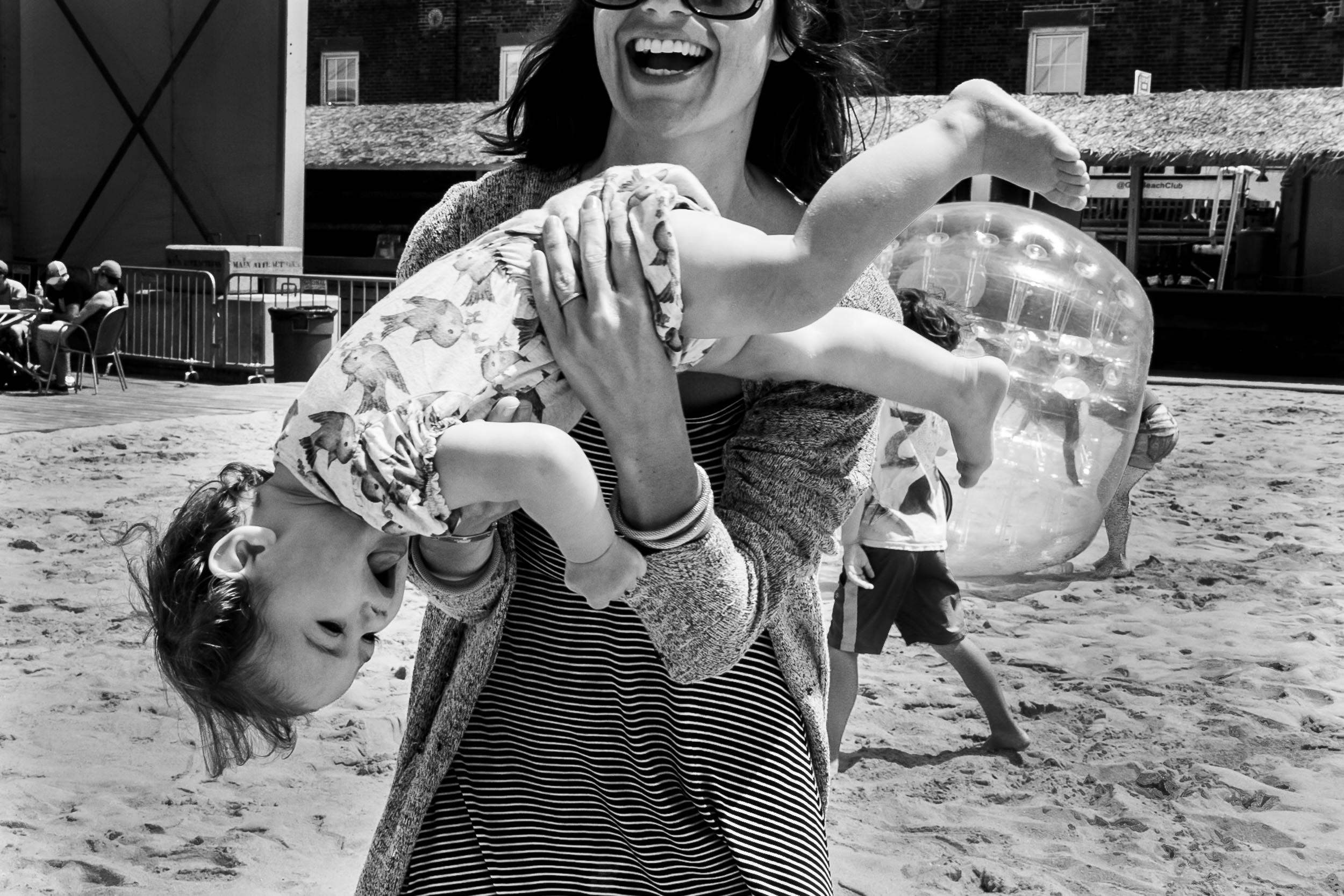Deborah-Barak-Documentary-Family-Photography-Brooklyn_NYC_laughing-mom-and-baby.jpg
