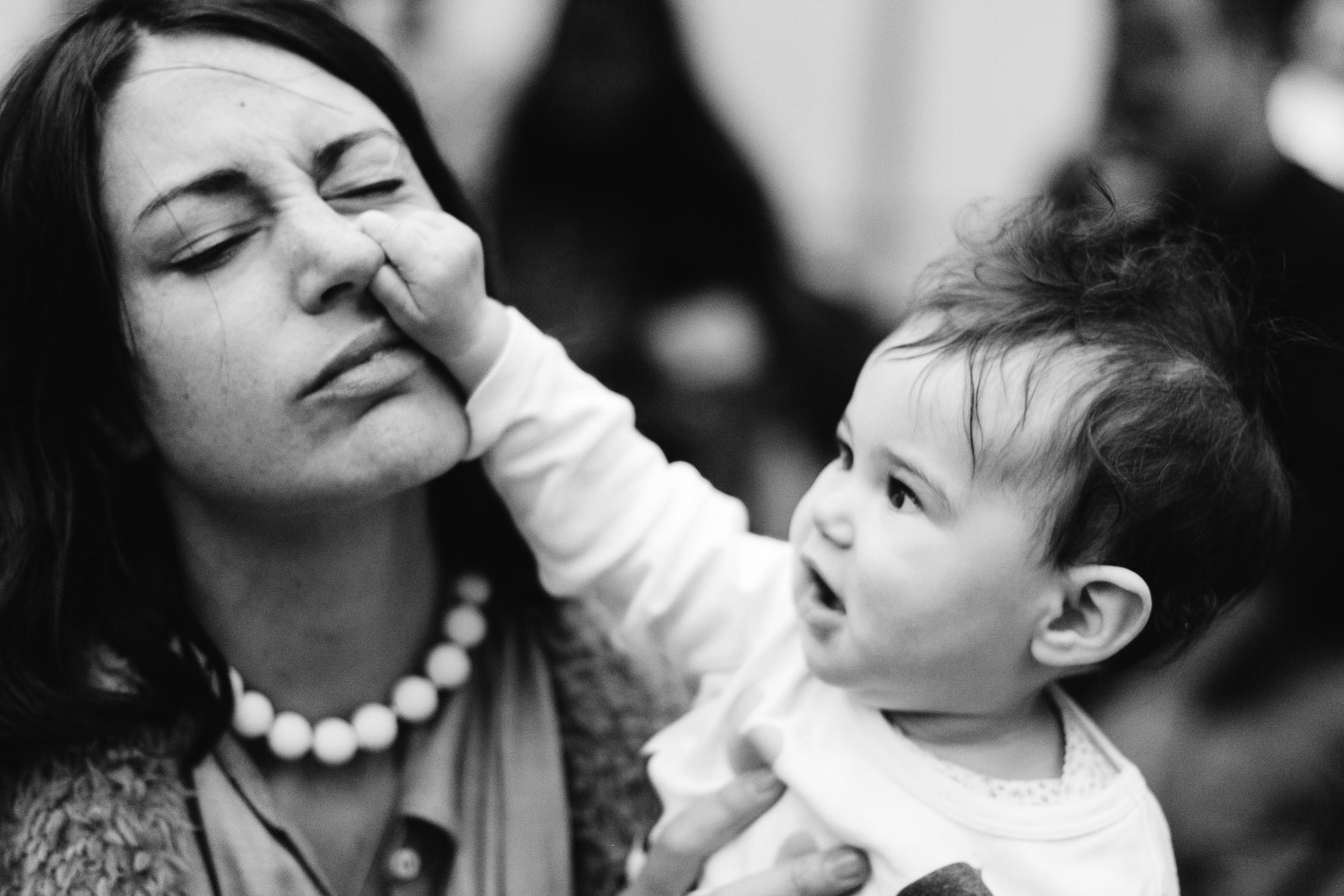 Deborah-Barak-Documentary-Family-Photography-Brooklyn_NYC_baby-finger-in-moms-nose.jpg